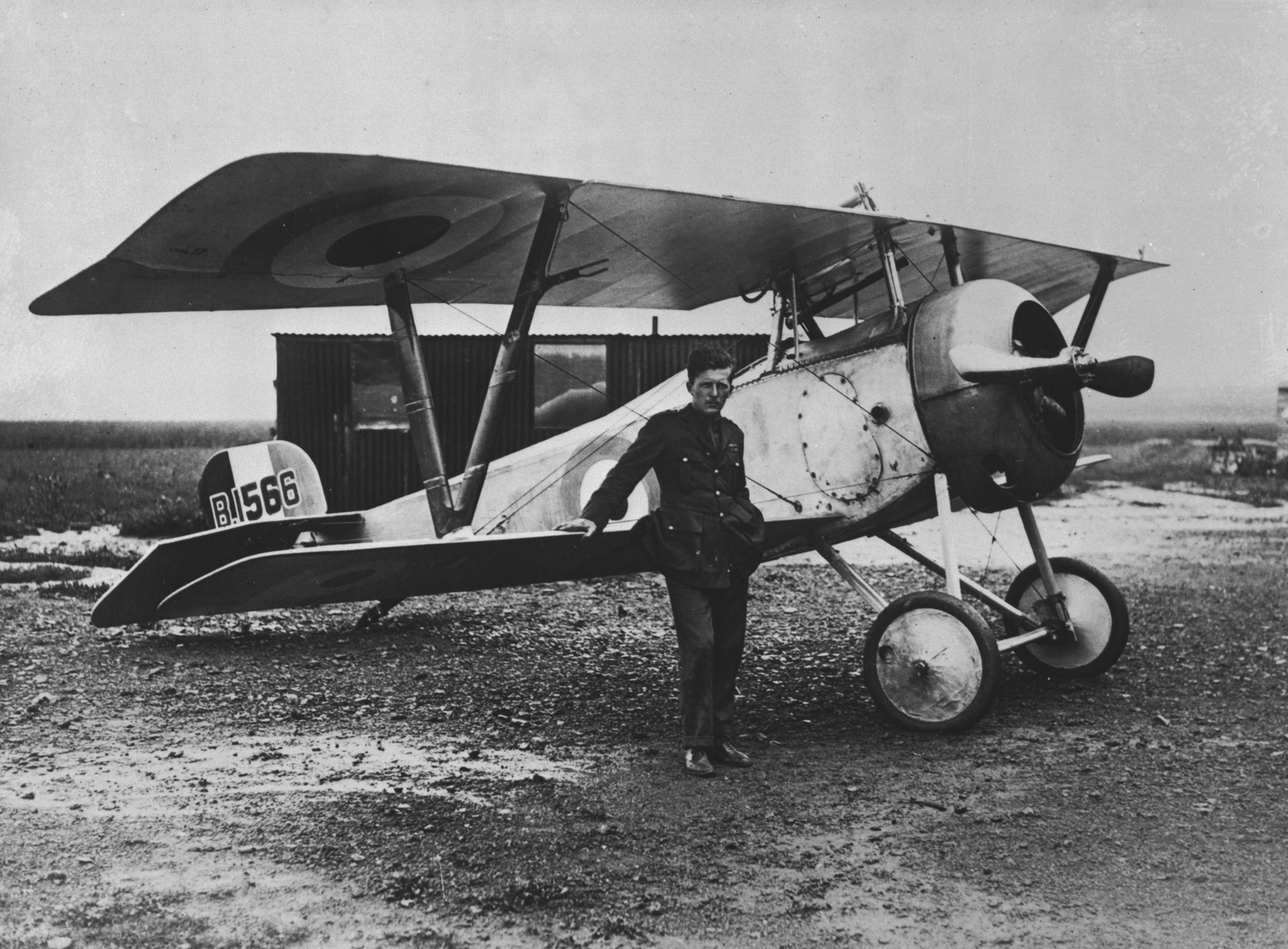 "Captain William A. ""Billy"" Bishop poses with his Nieuport Scout B1566, which he flew while with No. 60 Squadron, on August 6, 1917. PHOTO: DND Archives, AH-504"