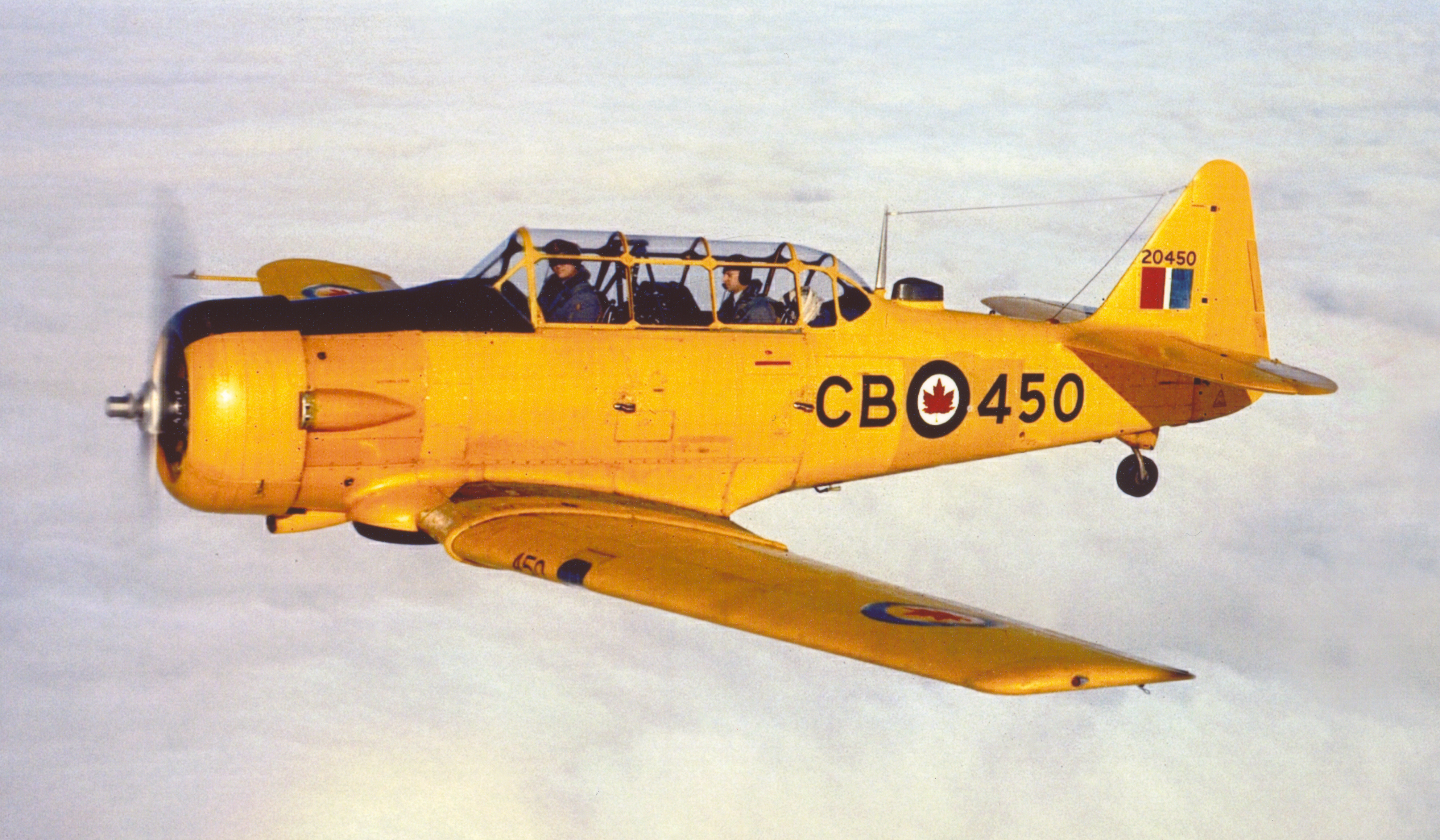"A late-model Harvard in post-war RCAF service. Nicknamed the ""Yellow Peril"", the Harvard's overall yellow paint scheme was mandatory for training aircraft. PHOTO: DND"
