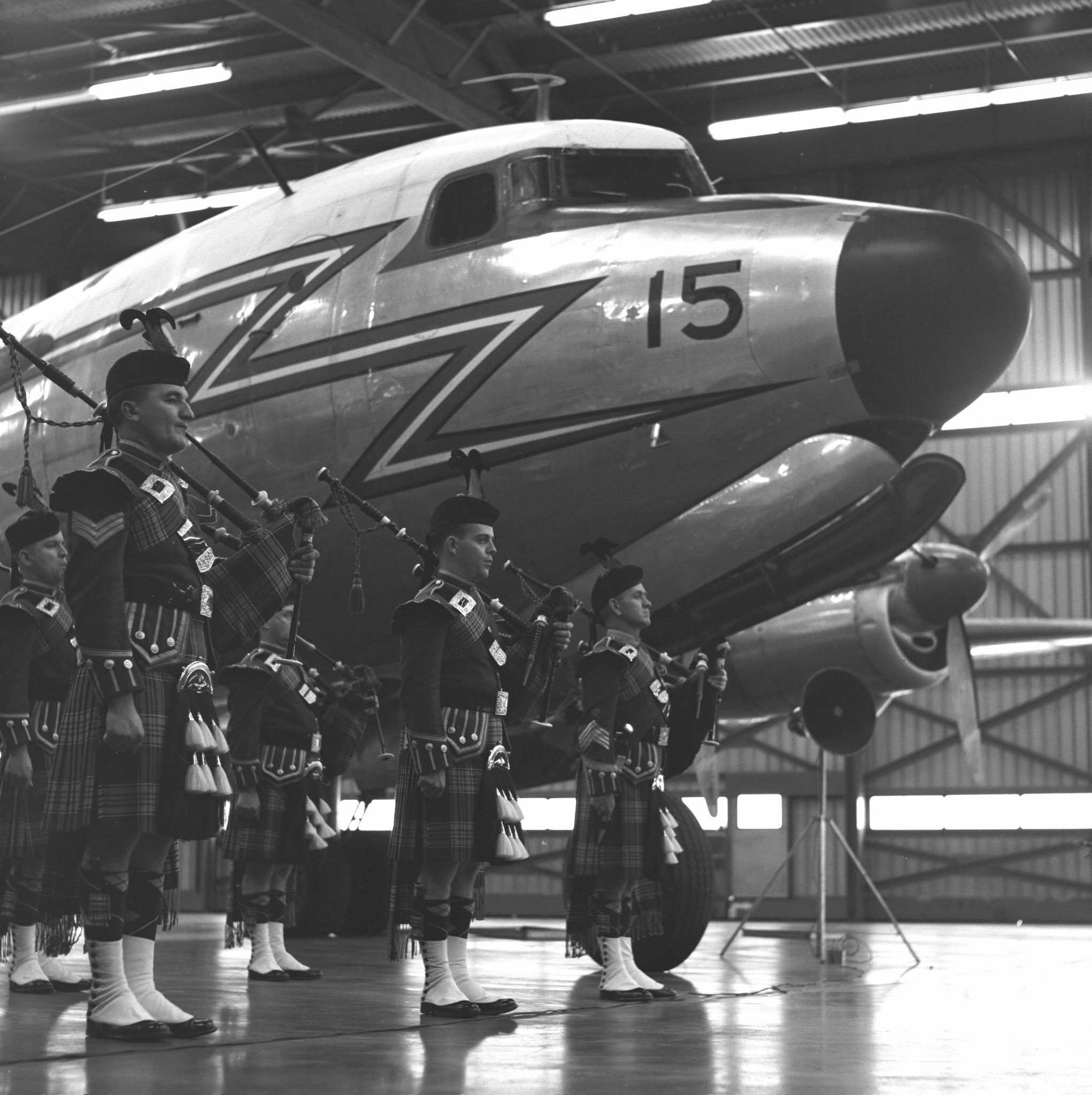 The RCAF Pipe Band stands in front of the RCAF's last North Star during the aircraft's retirement ceremony. PHOTO: DND Archives, Z-10578-2
