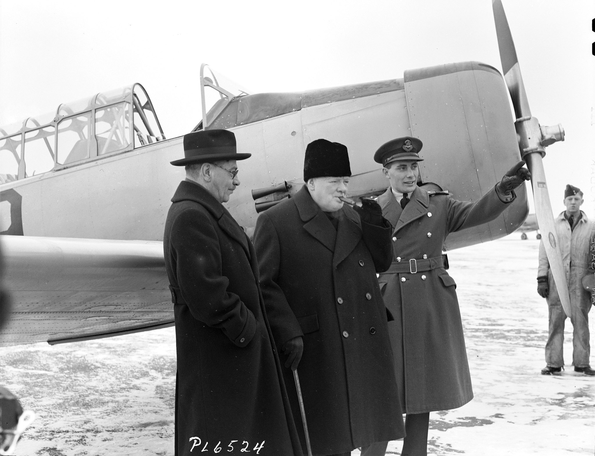 British Prime Minister Winston Churchill (centre) visits the British Commonwealth Air Training Plan school at RCAF Uplands, Ontario, in December 1941 with Canadian Air Minister C.G. Power (left) and Wing Commander W.R. MacBrien. PHOTO: DND Archives