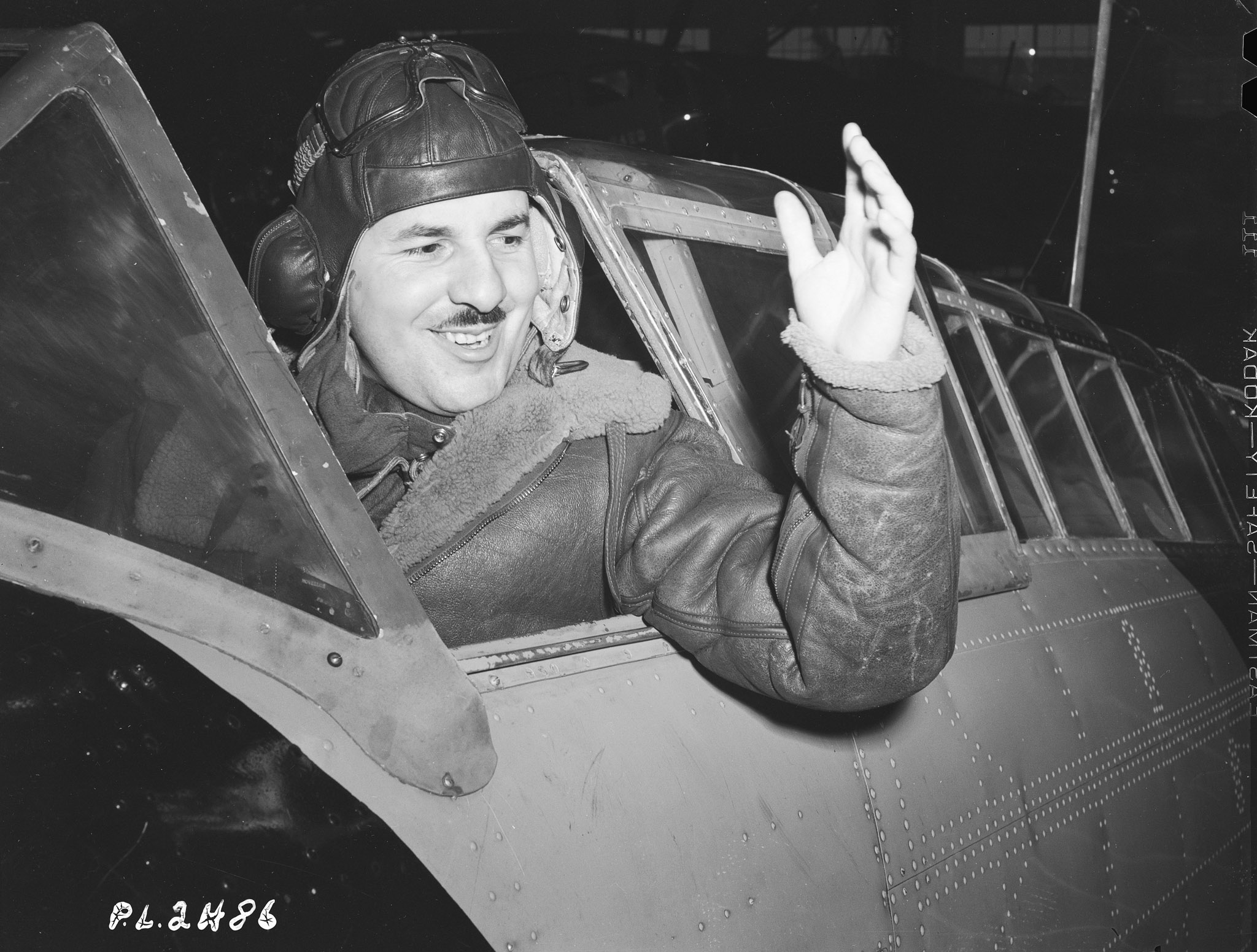 Fight Lieutenant Jean-Paul Desloges waves from his aircraft on January 22, 1941.
