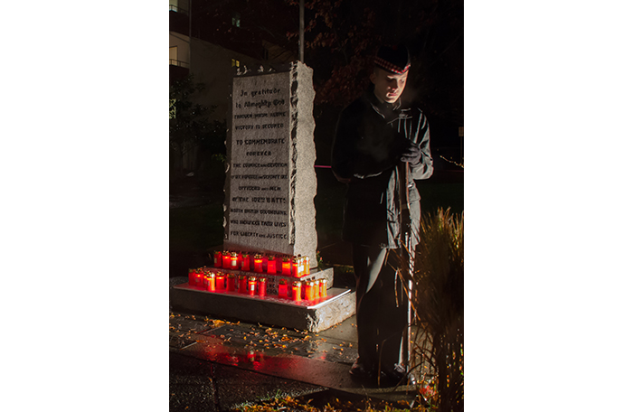 slide - Cadet Warrant Officer Paul LeClere stands vigil at the Comox, British Columbia, cenotaph following a candlelight ceremony on November 10, the eve of Remembrance Day 2015.