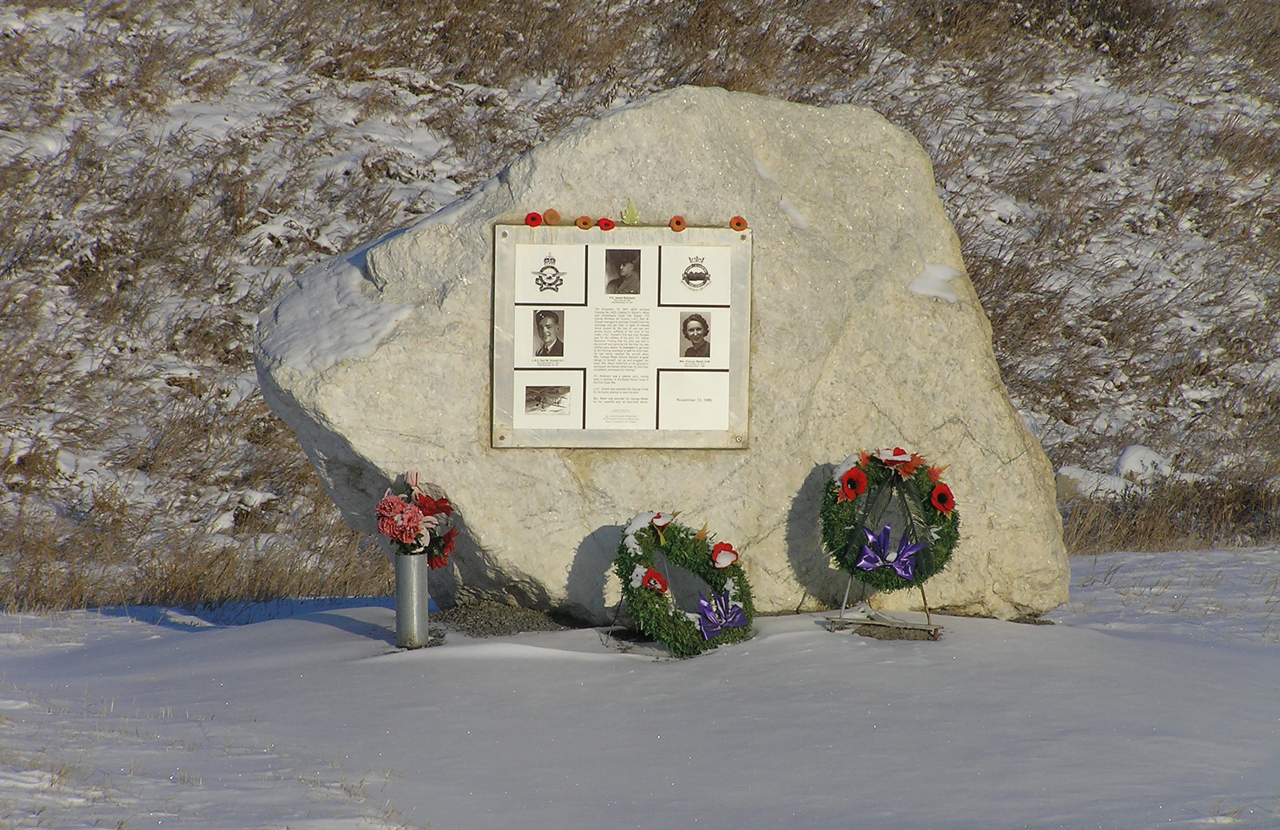 In 1995, through the efforts of 18-year-old air cadet Sergeant Daniel Fitzgerald, a Memorial was placed near the site of the November 10, 1941, crash of a Moth training aircraft near Simmonds Valley, Alberta. The plaque honours the pilot of the aircraft, Flying Officer James Robinson (top), who died in the crash; his student pilot, Leading Aircraftman Karl Gravell, from No. 2 Wireless School, who died about four hours after the crash; and Ms Frances Walsh, a teacher who left her classroom and ran to the nearby crash site in an attempt to save the gravely injured Gravell who was trying to rescue his pilot. PHOTO: Submitted