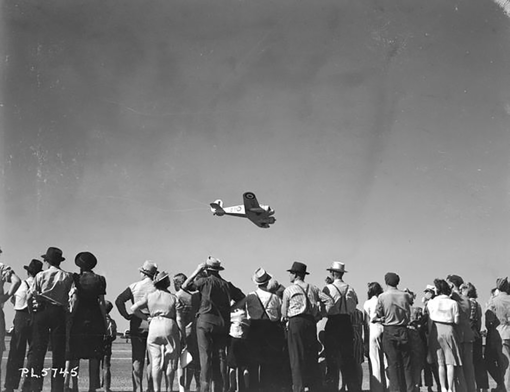 A Cessna Crane buzzes the field during the July 19, 1941, official opening ceremonies of No. 12 Service Flying Training School at Brandon, Manitoba. PHOTO: DND Archives, PL-5745