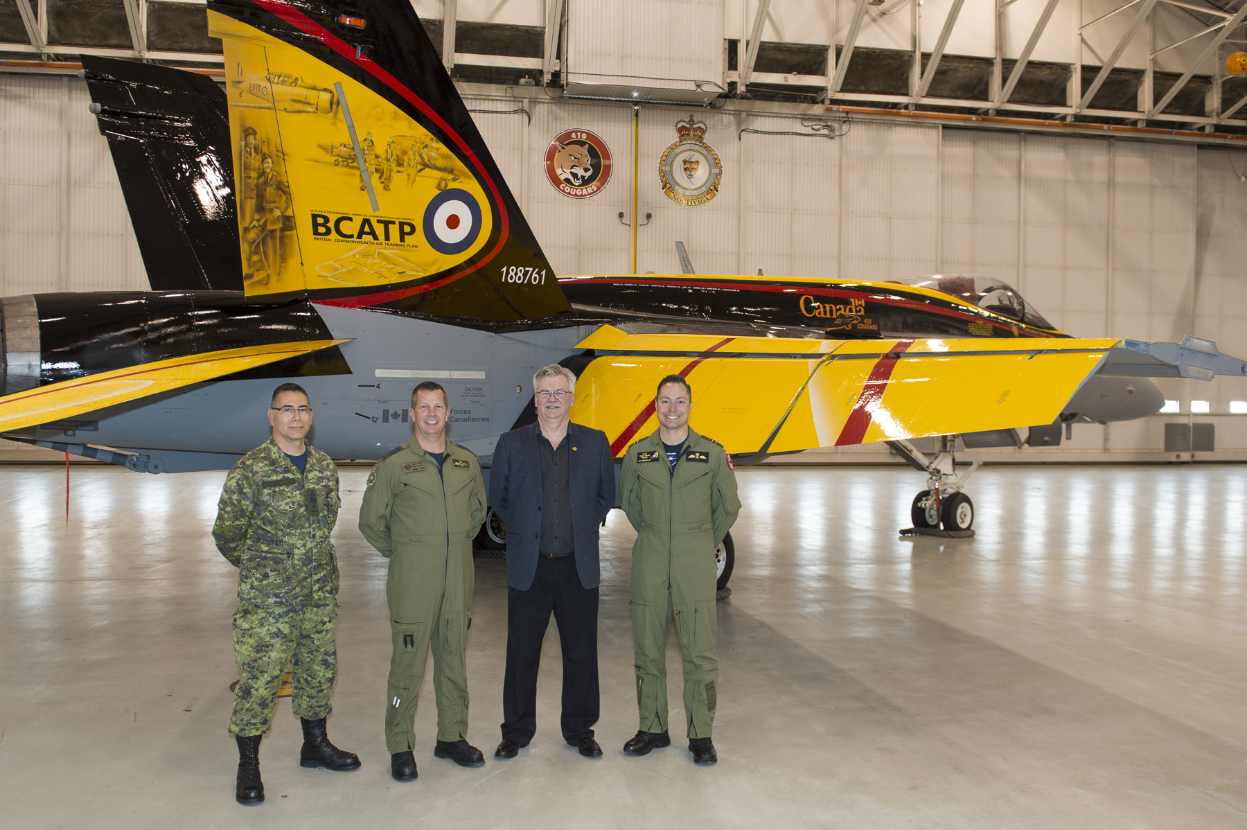 (From left to right) Chief Warrant Officer Alain Roy, 4 Wing Cold Lake's chief warrant officer, Colonel Eric Kenny, commander of 4 Wing; Mr. Jim Belliveau, design and paint crew lead; and Captain Ryan Kean, the CF-18 Demonstration Hornet pilot, during the Hornet's unveiling ceremony held at 4 Wing Cold Lake, Alberta, on April 5, 2016. PHOTO: Corporal Bryan Carter, CK04-2016-0278-004
