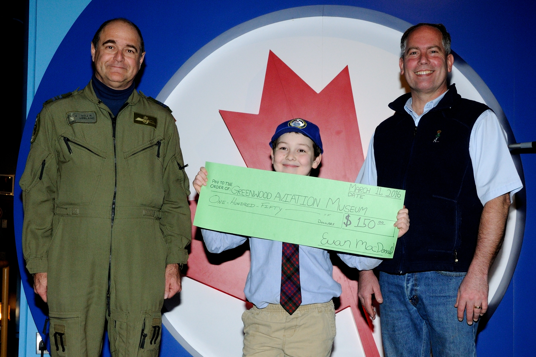 Euan MacDonald left some of the fund raised – $150 – for his own Lancaster dream with Major Richard LeBlanc and Dave Saulnier at the Greenwood Military Aviation Museum on March 11, 2016, following a specially-arranged tour of the museum and 14 Wing Greenwood. He wanted to support restoration work on the museum's Lancaster project and he pledged another $500, so the dream grows bigger! PHOTO: Sergeant Peter Nicholson, GP2016-0041