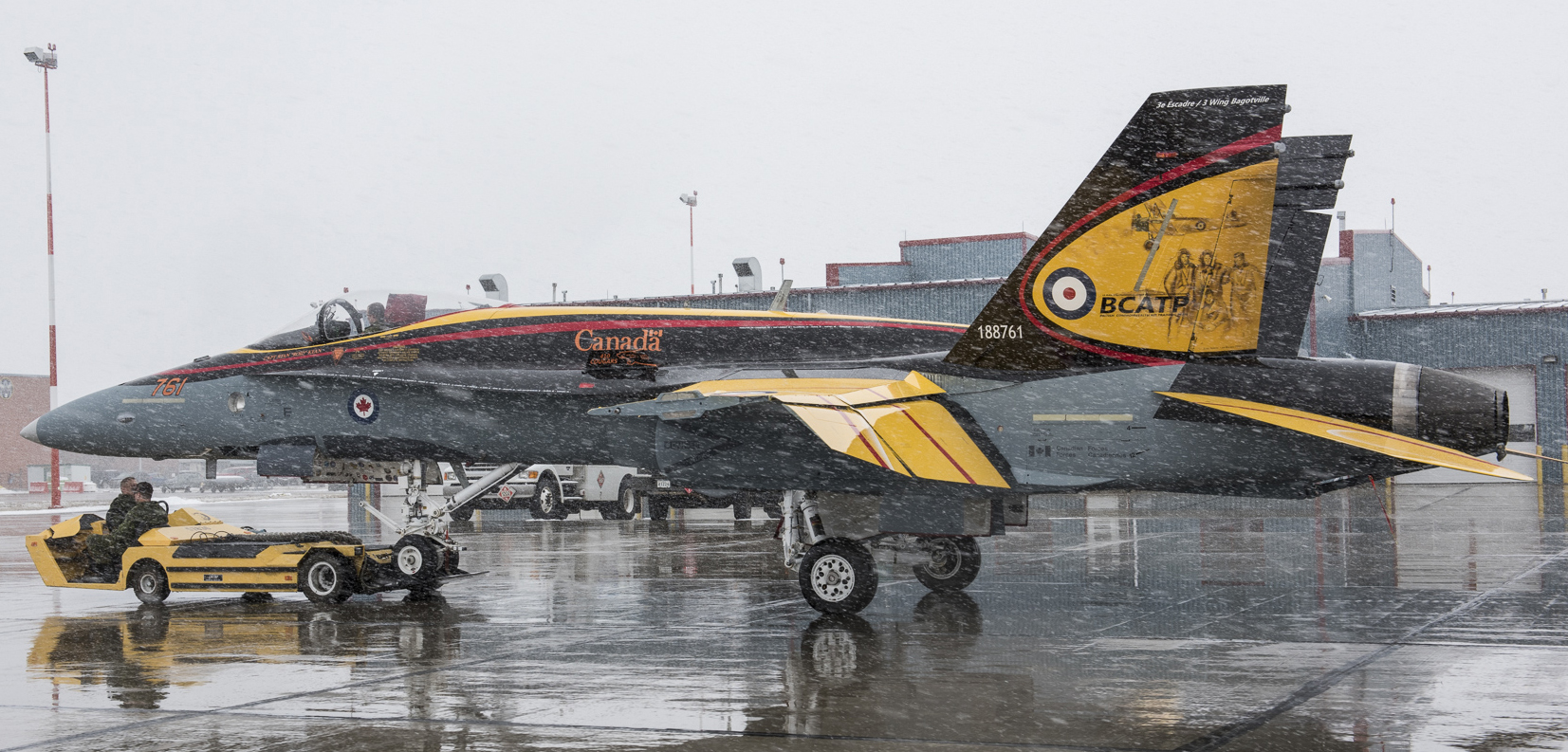 "The 2016 Demonstration Hornet is painted in a design reflecting the British Commonwealth Air Training Plan, one of the greatest training programs the world has ever seen. The yellow echoes the yellow-painted training aircraft used by the BCATP while the black conveys a message about the darkness of the Second World War. And the red represents the training plan – ""the motif of the flame against the darkness"". PHOTO: Corporal I. Thompson, CK02-2016-0278-001"