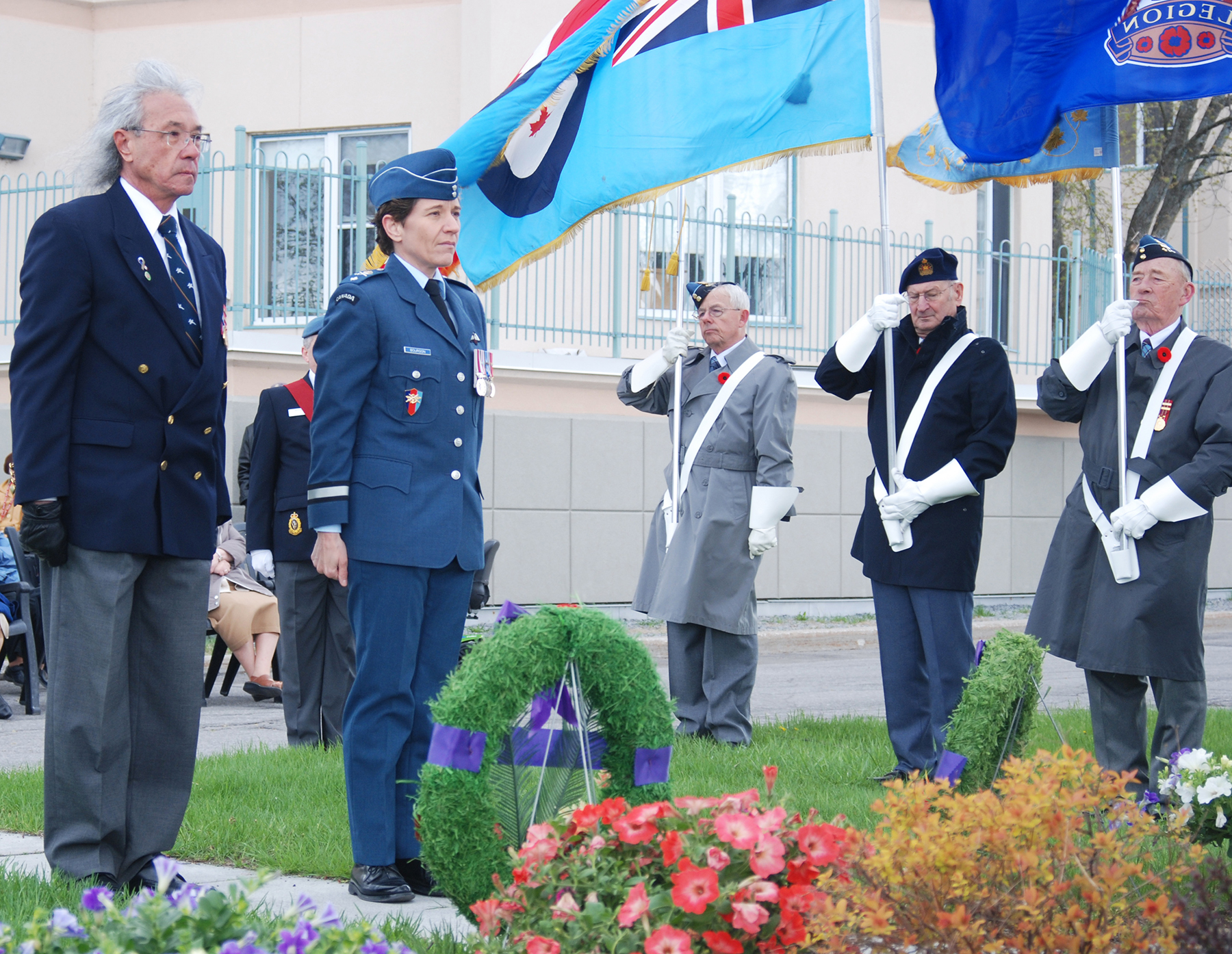Brigadier-General Lise Bourgon pauses for a moment of silence during the 60th anniversary commemorative ceremony of the CF-100 crash in Orléans, Ontario.