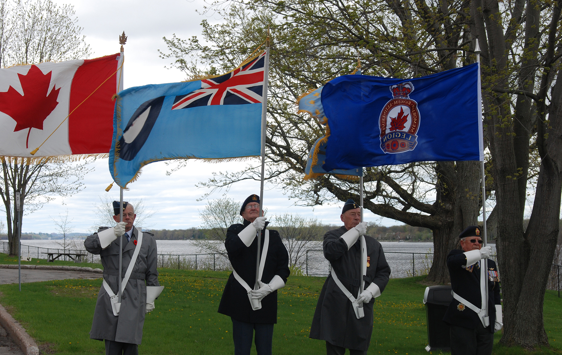 Members from the Royal Canadian Legion Branch 632, Knights of the Round Table (a group of former RCAF airmen) and 410 Wing Royal Canadian Air Force Association hold the flags during the CF-100 crash 60th anniversary commemorative ceremony at Bruyère Village in Orléans, Ontario on May 15, 2016.