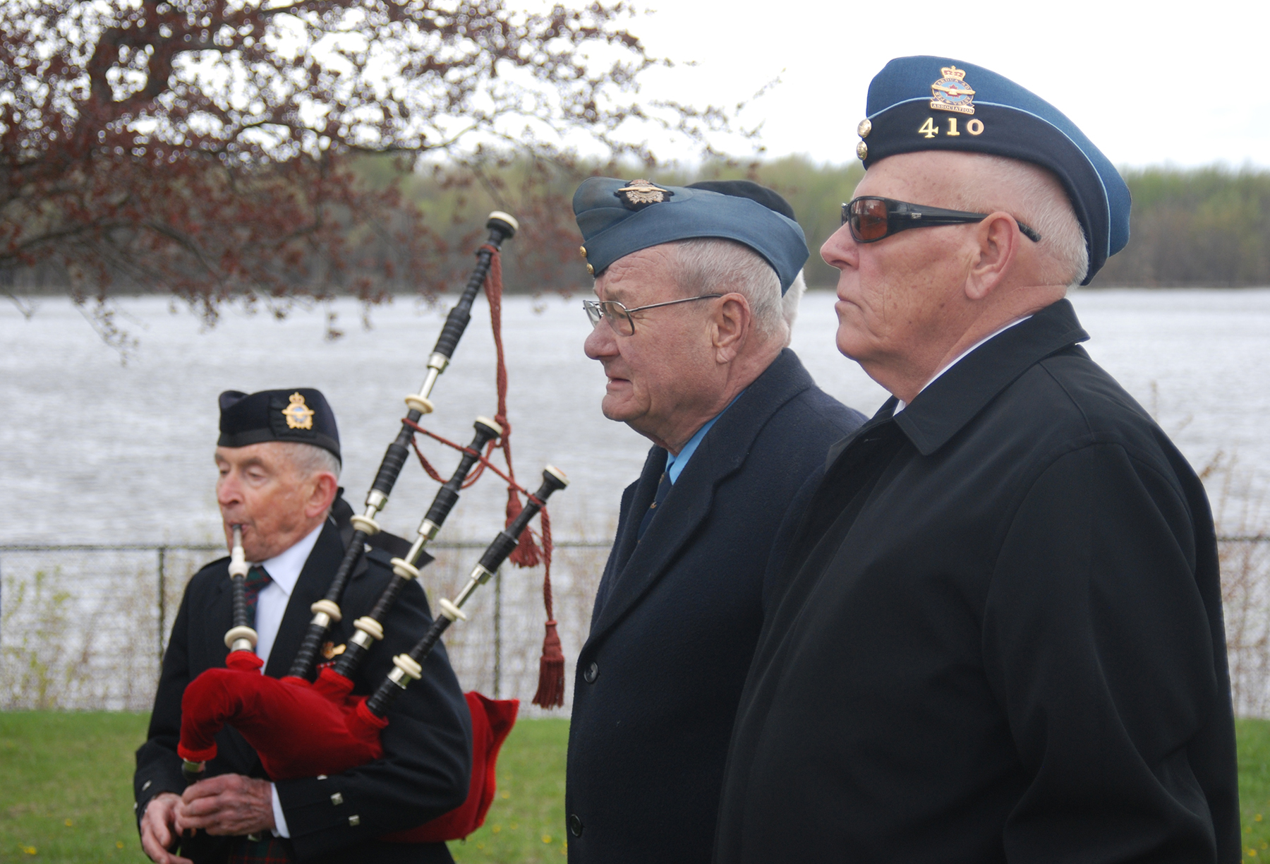Veterans from the Royal Canadian Legion and 410 Wing Royal Canadian Air Force Association take a moment to reflect during the Piper's Lament at the 60th anniversary ceremony of a CF-100 crash in Orléans, Ontario on May 15, 2016.