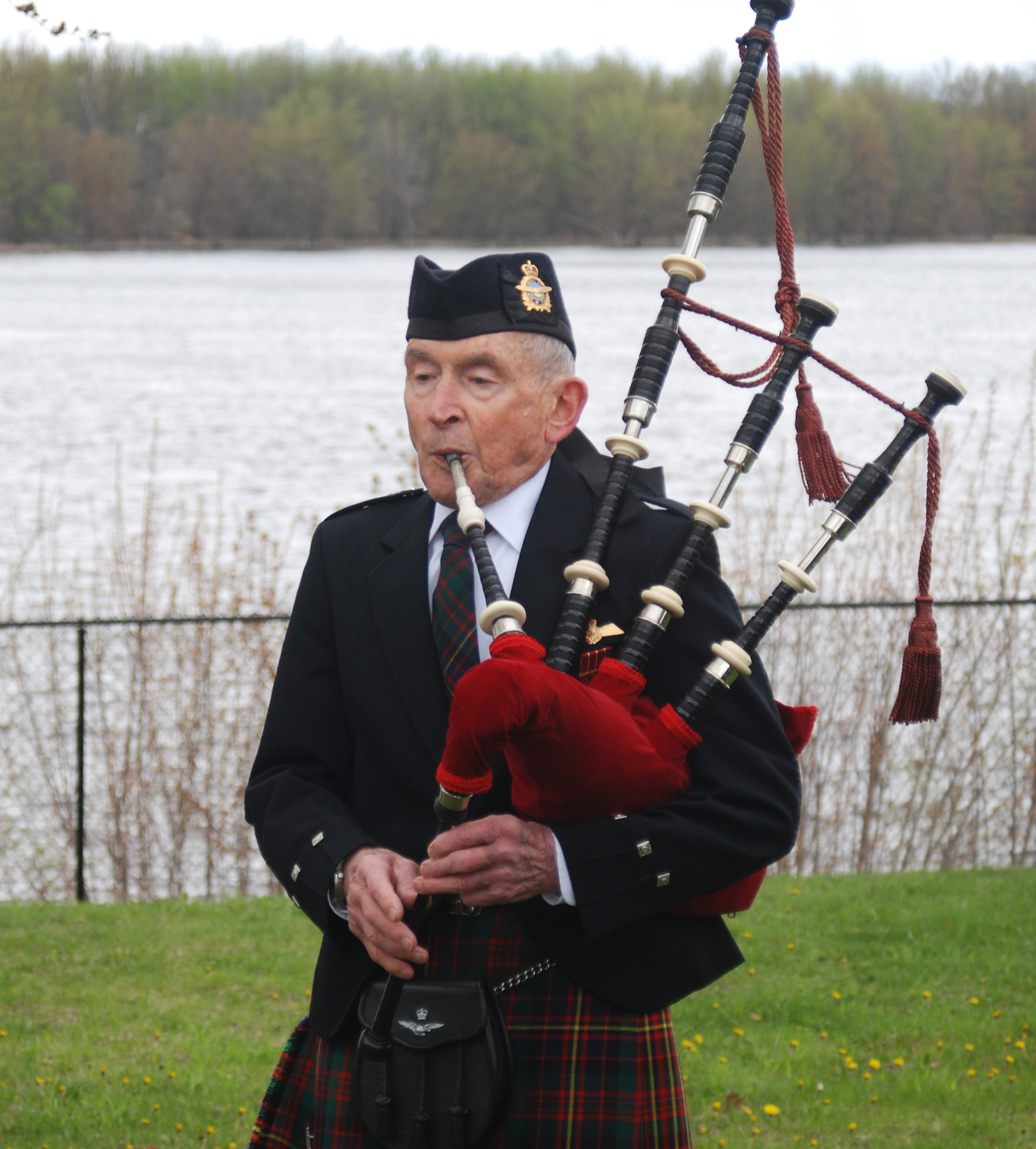 "A piper plays ""Flowers of the Forest"" during the 60th anniversary ceremony of a CF-100 crash in Orléans, Ontario on May 15, 2016.