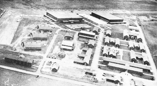 An undated aerial photograph of No. 5 Elementary Flying Training School at High River, Alberta, reveals the familiar footprint of Elementary Flying Training Schools throughout Canada. Most of the staff at No. 5 Elementary Flying Training School was civilian, but gradually many of the instructors became RCAF officers. While the instruction of personnel for the war overseas was the priority of any British Commonwealth Air Training Plan school, the social background to the instruction played an important supporting role. 5 EFTS had an orchestra; a band; a recreation hall that was used regularly for concerts, dramatic productions, and movies; and a stable to house the horses used by the riding club. PHOTO: Bomber Command Museum