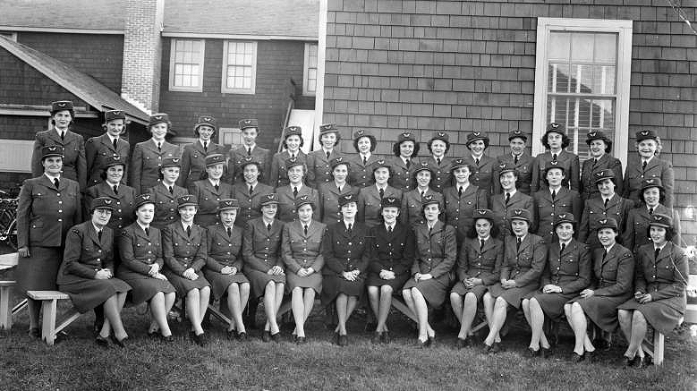 Members of the Women's Division of the Royal Canadian Air Force gather for a photograph at No. 5 Elementary Flying Training School at High River, Alberta. PHOTO: Bomber Command Museum