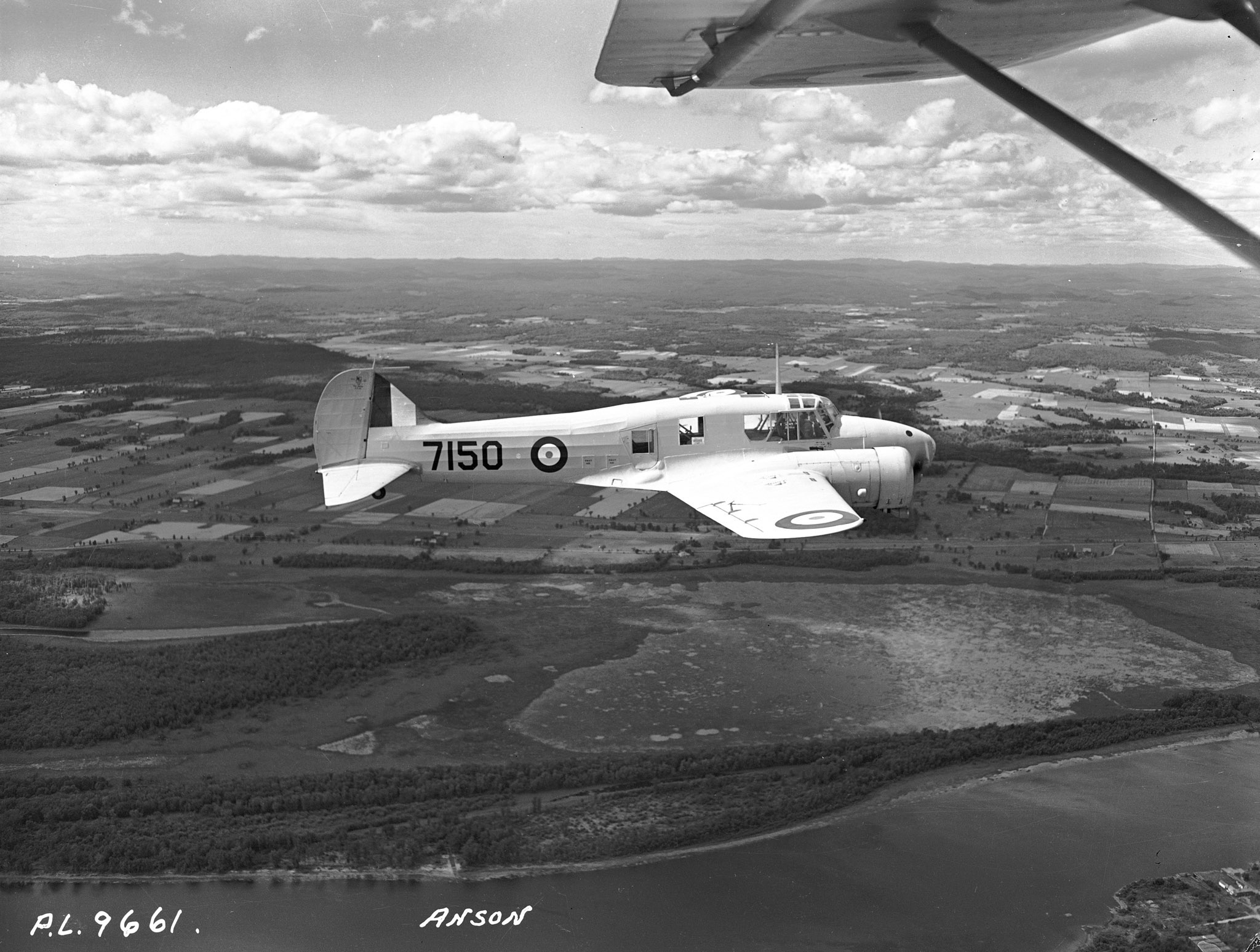 Under the British Commonwealth Air Training Plan, RCAF Avro Anson Mark II twin-engine aircraft such as No. 7150, photographed on August 4, 1942, introduced some 30,000 navigators, including Leading Aircraftman Kenneth Spooner, and wireless operators to their jobs in the sky at schools throughout Canada. PHOTO: DND Archives, PL-9661