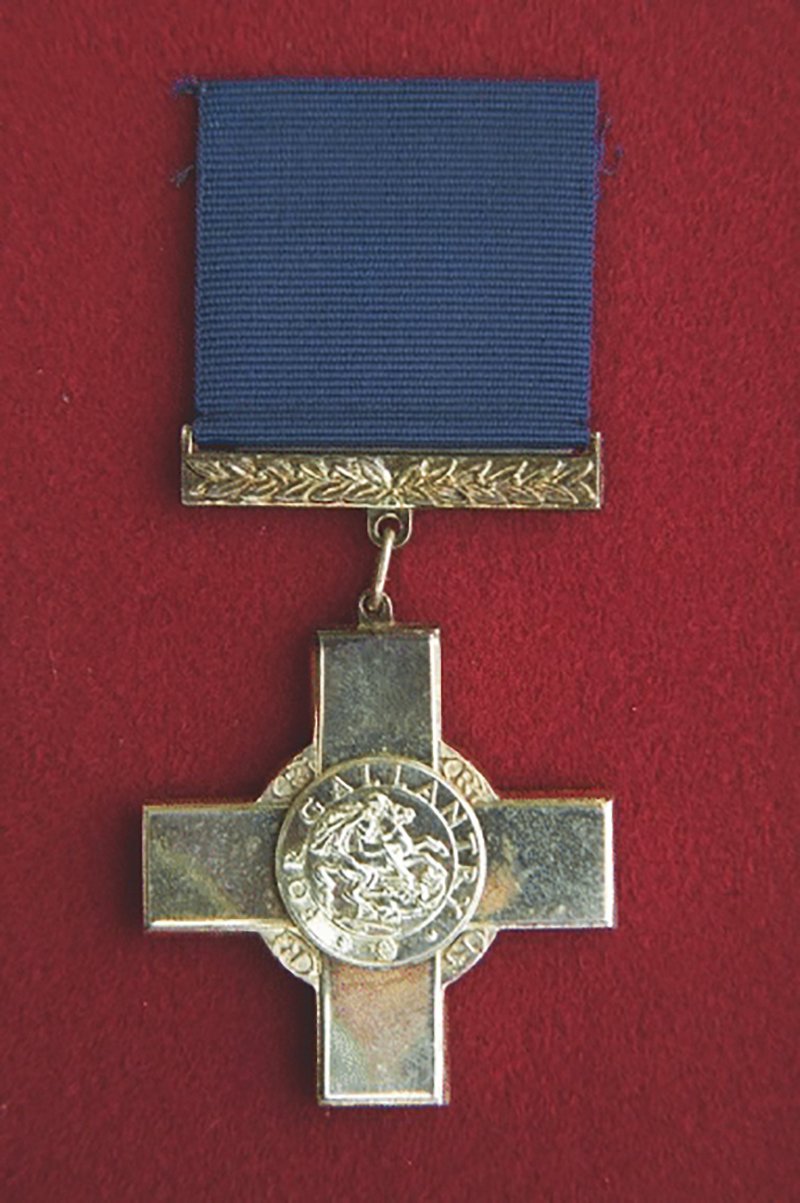 The George Cross. The cross was awarded for an act of the greatest heroism or of the most conspicuous courage in circumstances of extreme danger. It was intended primarily for civilians and award in the military services was confined to actions for which purely military honours were not normally granted and actions not in the face of the enemy. IMAGE: Veterans Affairs Canada