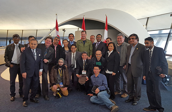 slide - A group photo of Lieutenant-General Mike Hood, commander of the Royal Canadian Air Force, met with members of the National Ethnic Press and Media Council of Canada