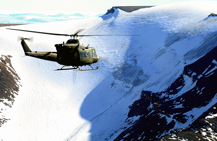 slide - A Griffon helicopter flies mountains.