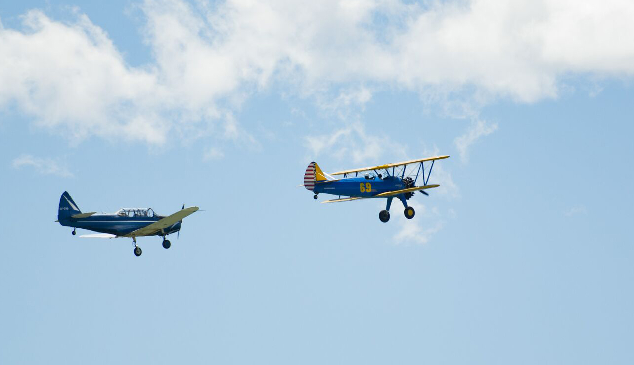 Guests and spectators attending No. 31 Elementary Flying training School's 75th anniversary reunion on June 15, 2016, were treated to the sight of a Fairchild Cornell (left) and a Stearman PT-27 flying together. Both aircraft were flown by students at the school during the Second World War. PHOTO: Courtesy of Anne Gafiuk