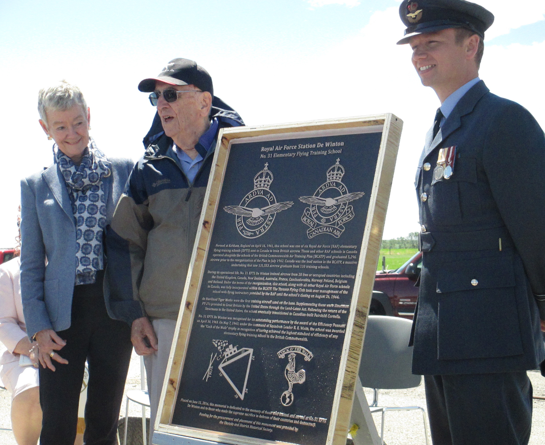 Susan Cowan, the daughter Squadron Leader Ron Watts, a commanding officer of No. 31 Elementary Flying Training School De Winton; Squadron Leader Rae Churchill, a Second World War flying instructor; and Flight Lieutenant James Andrews of the Royal Air Force, unveiled a memorial plaque during the school's 75th anniversary reunion on June 15, 2016. PHOTO: Courtesy of Anne Gafiuk