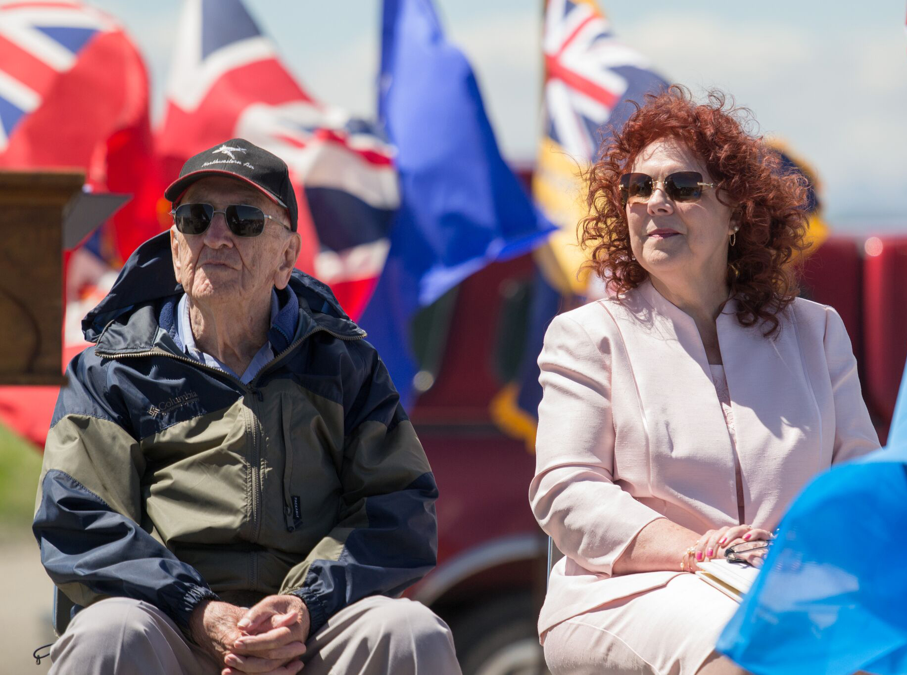 Squadron Leader Rae Churchill and United Church minister Susan Wilkinson-Matticks listen to the speakers during No. 31 Elementary Flying Training School De Winton's 75th anniversary celebration on June 15, 2016. PHOTO: Courtesy of Anne Gafiuk
