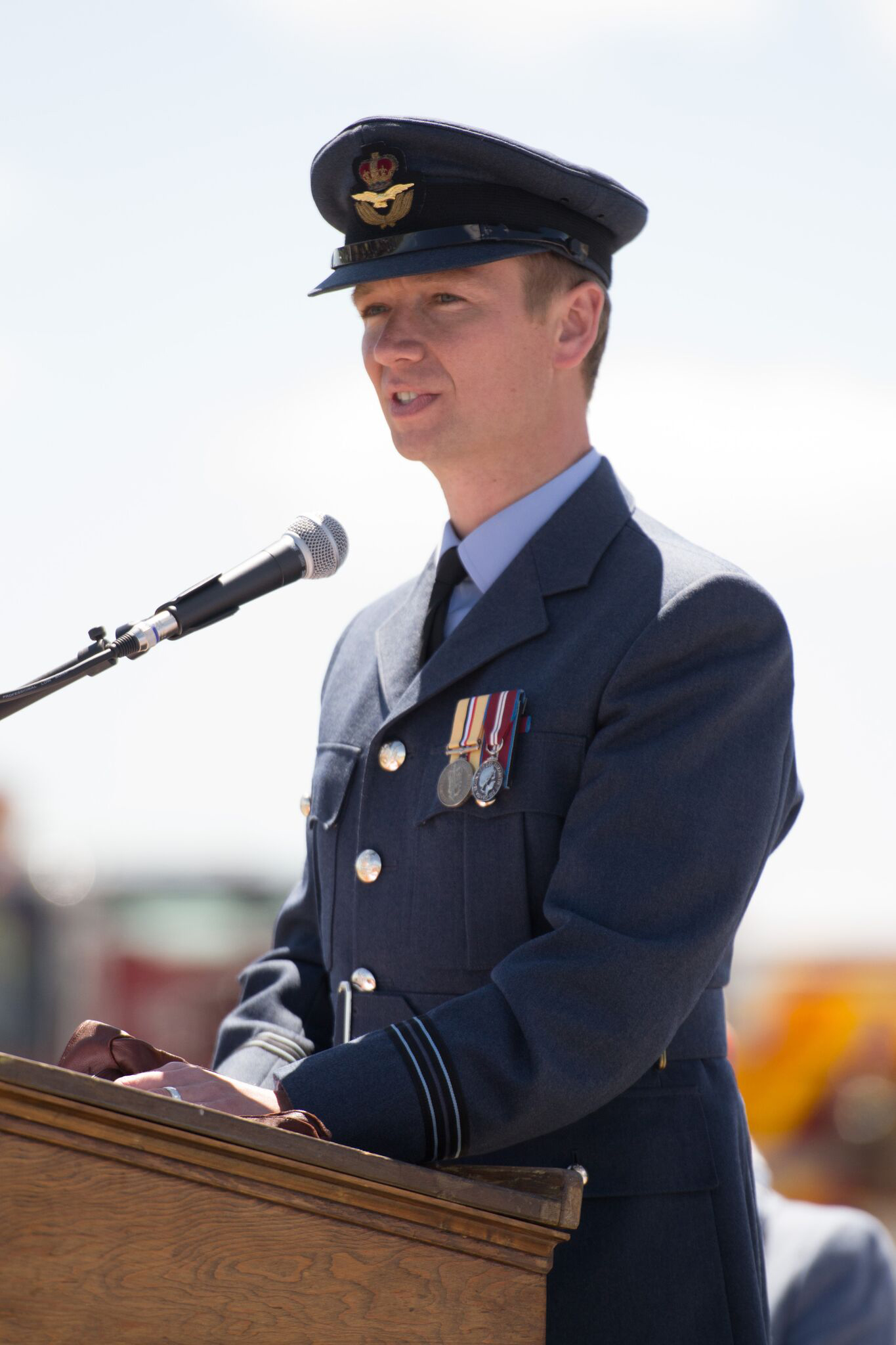 Flight Lieutenant James Andrews of the Royal Air Force addresses the crowd during No. 31 Elementary Flying Training School De Winton's 75th anniversary celebration on June 15, 2016. PHOTO: Courtesy of Anne Gafiuk