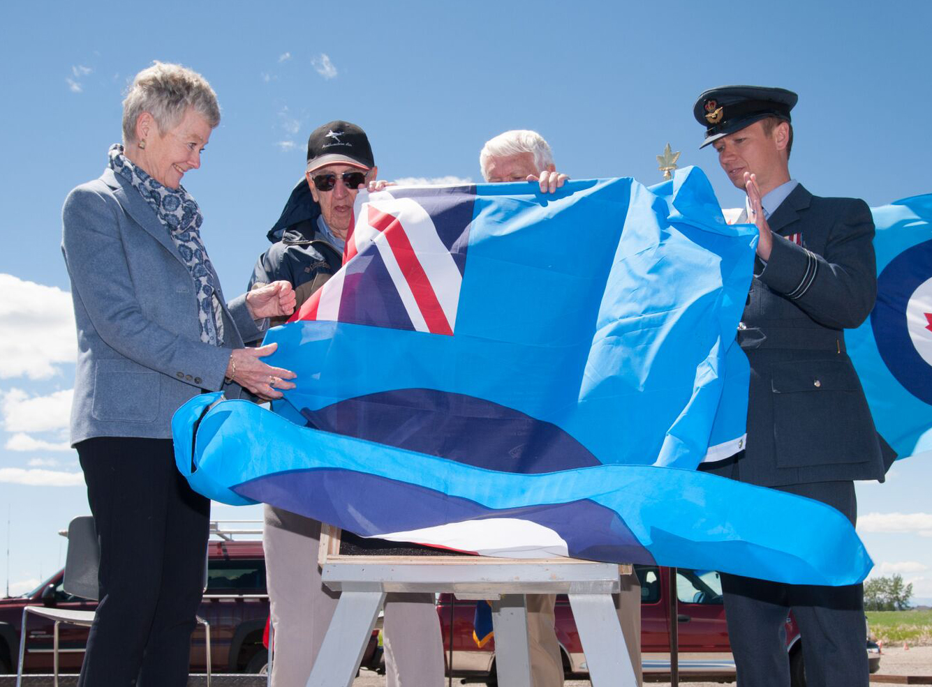 (Left to right) Susan Cowan, the daughter Squadron Leader Ron Watts, a commanding officer of No. 31 Elementary Flying Training School De Winton; Squadron Leader Rae Churchill, a Second World War flying instructor; Mr. Tim Johnston, master of ceremonies; and Flight Lieutenant James Andrews of the Royal Air Force, unveil the memorial plaque during the school's 75th anniversary reunion on June 15, 2016. PHOTO: Courtesy of Anne Gafiuk