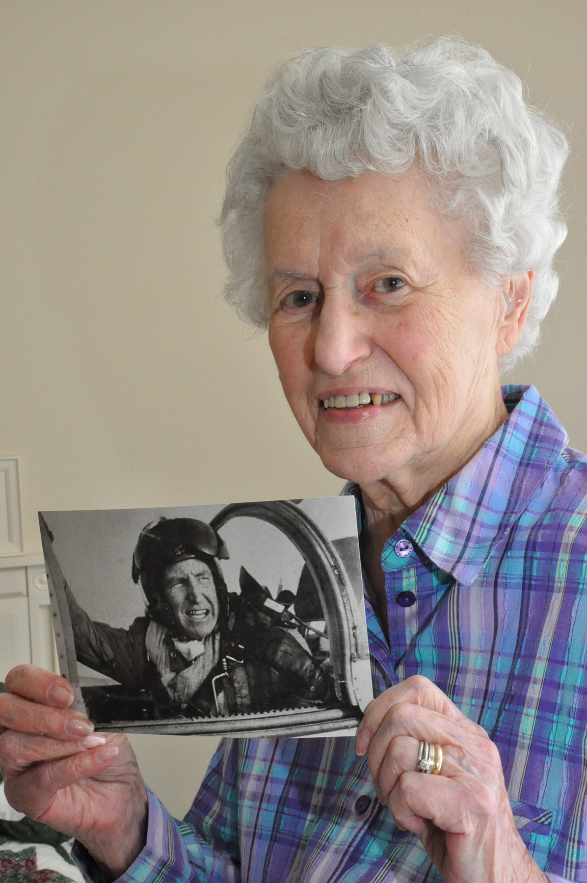 "Allison MacKenzie holds a photograph of her second husband, Squadron Leader Andy MacKenzie, the hero of the book ""Mayhem to Mayday"". PHOTO: Ross Lees"