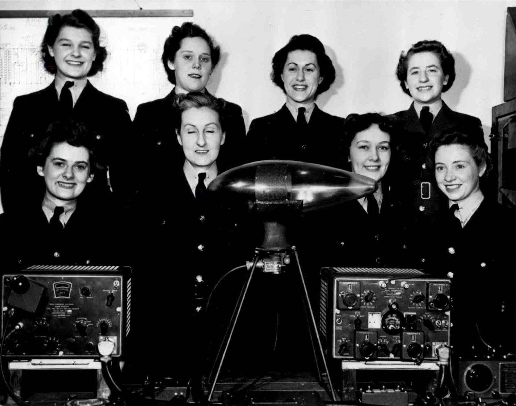 "Allison ""Sparky"" MacKenzie, née Sparks, (front row, second from right) and her fellow wireless operators stand with some of their equipment in an undated photograph. PHOTO: Courtesy of Allison MacKenzie"