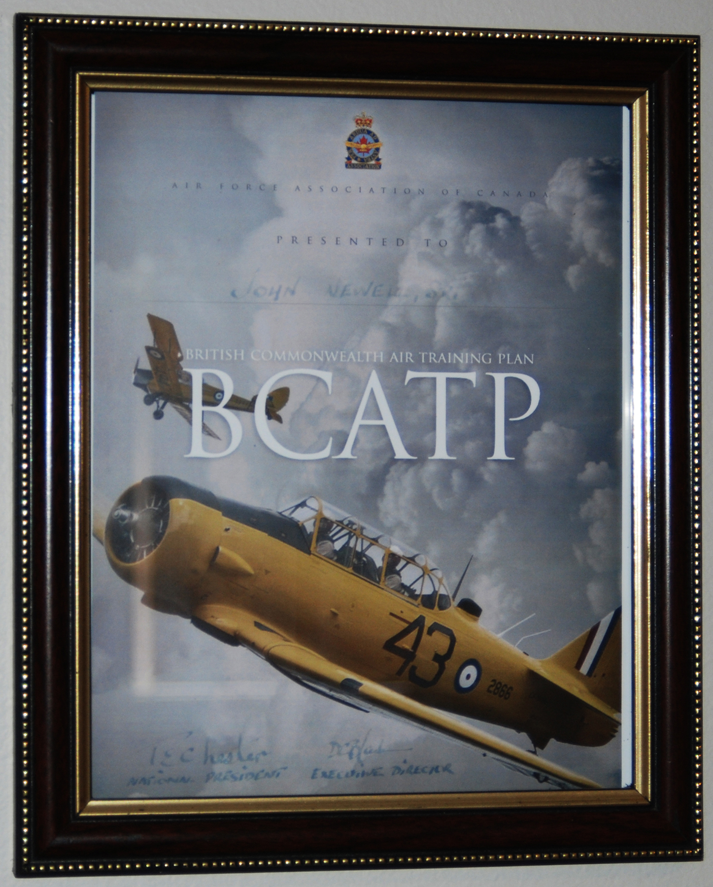 Hanging in a place of pride in Flying Officer (retired) John Newell's living room, a framed, undated commemorative certificate signed by the president and the executive director of the Air Force Association of Canada recognizes his contributions as an instructor under the British Commonwealth Air Training Plan during the Second World War. PHOTO: Alexandra Baillie-David