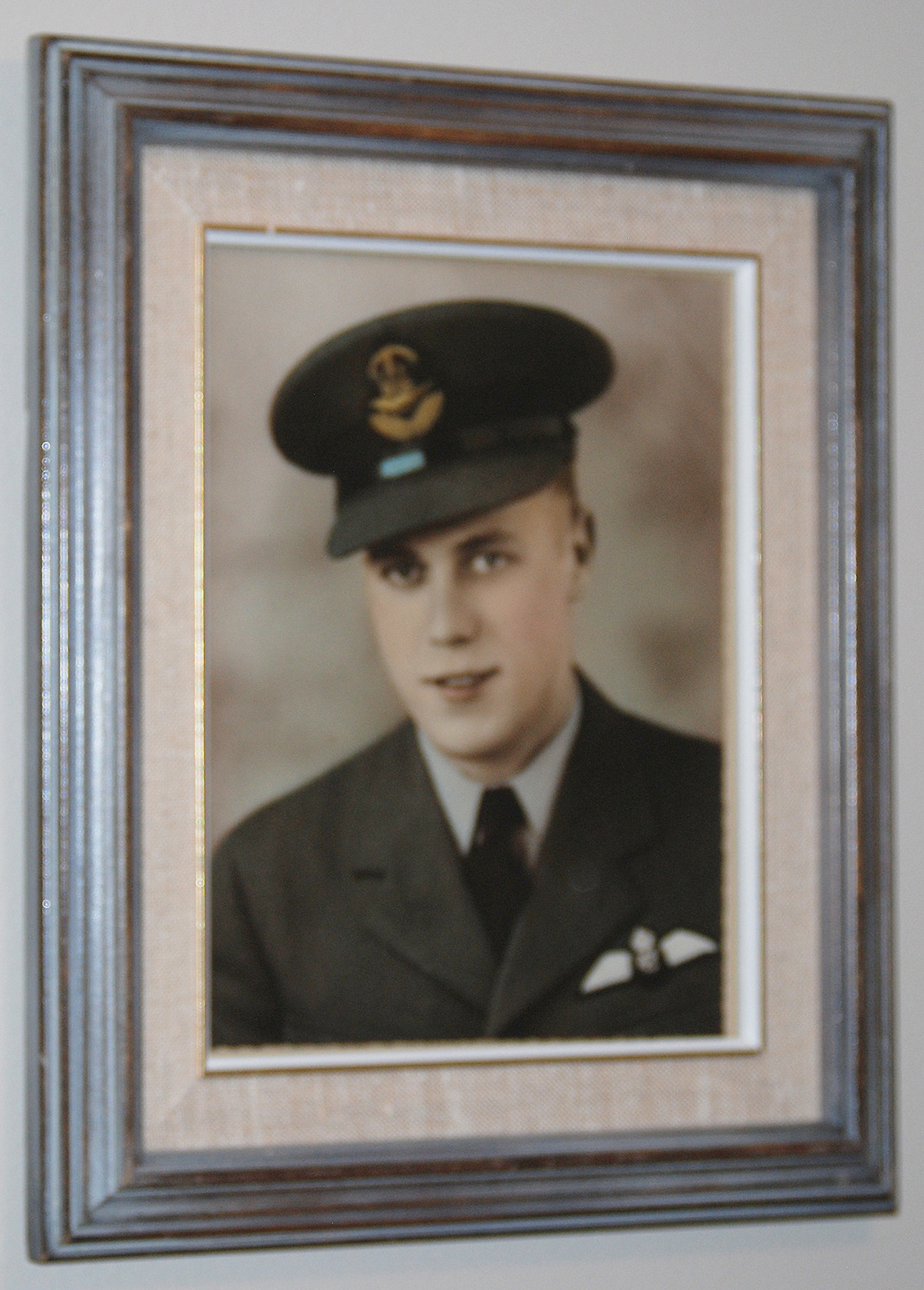 Flight Sergeant John Newell wears his wings with pride in a framed, undated image hanging in his home in in Ottawa, Ontario. PHOTO: Alexandra Baillie-David