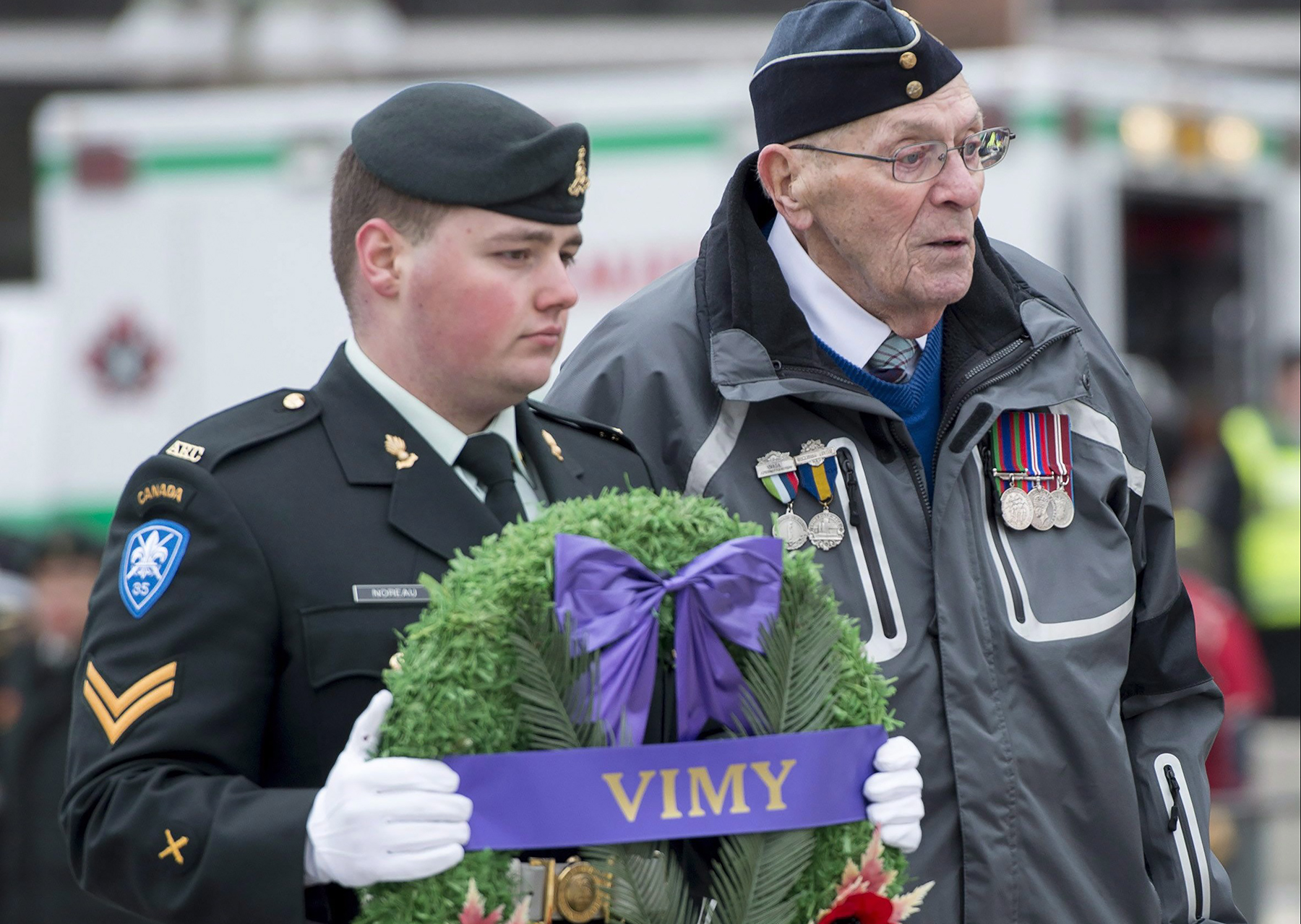 Flying Officer (retired) John R. Newell (right) prepares to lay a wreath during the ceremony marking the 98th anniversary of the Battle of Vimy Ridge at the National War Memorial in Ottawa on April 9, 2015. PHOTO: City News, The Canadian Press/Justin Tang