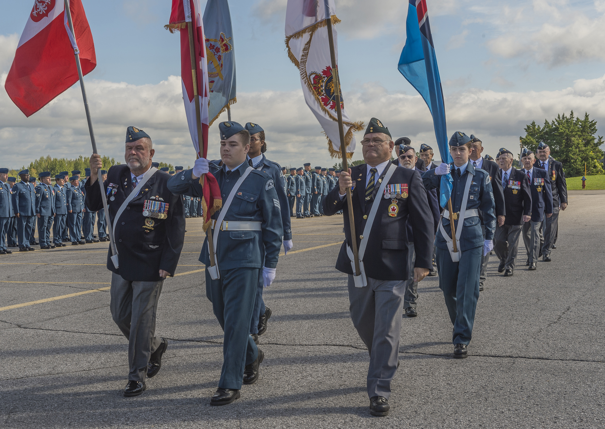 Members of 410 (William Barker, VC) Wing of the RCAF Association and members of the 872 Kiwanis Kanata Squadron of the Royal Canadian Air Cadets lead the veterans' contingent onto the parade square during the 2016 national Battle of Britain ceremony at the Canada Aviation and Space Museum in Ottawa on September 18. PHOTO: Corporal Alana Morin, FA03-2016-0032-011
