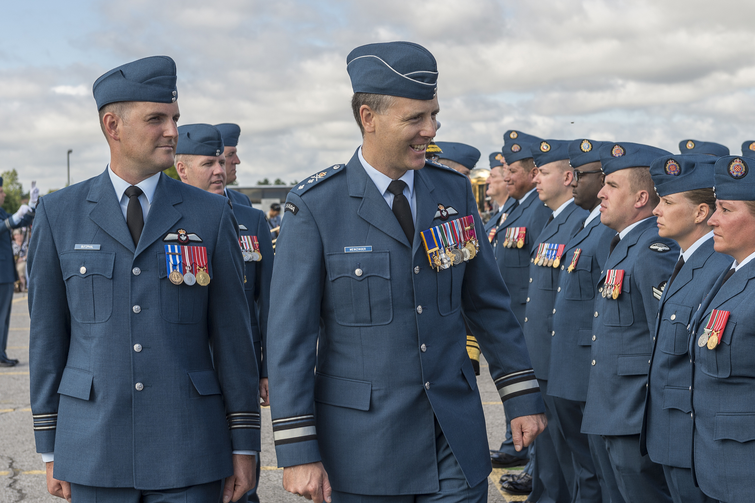 Accompanied by the parade commander, Major Peter Butzphal, Major-General Al Meinzinger, deputy commander of the Royal Canadian Air Force, inspects the airmen and airwomen on parade during the national Battle of Britain ceremony held September 18, 2016. PHOTO: Corporal Alana Morin, FA03-2016-0032-015