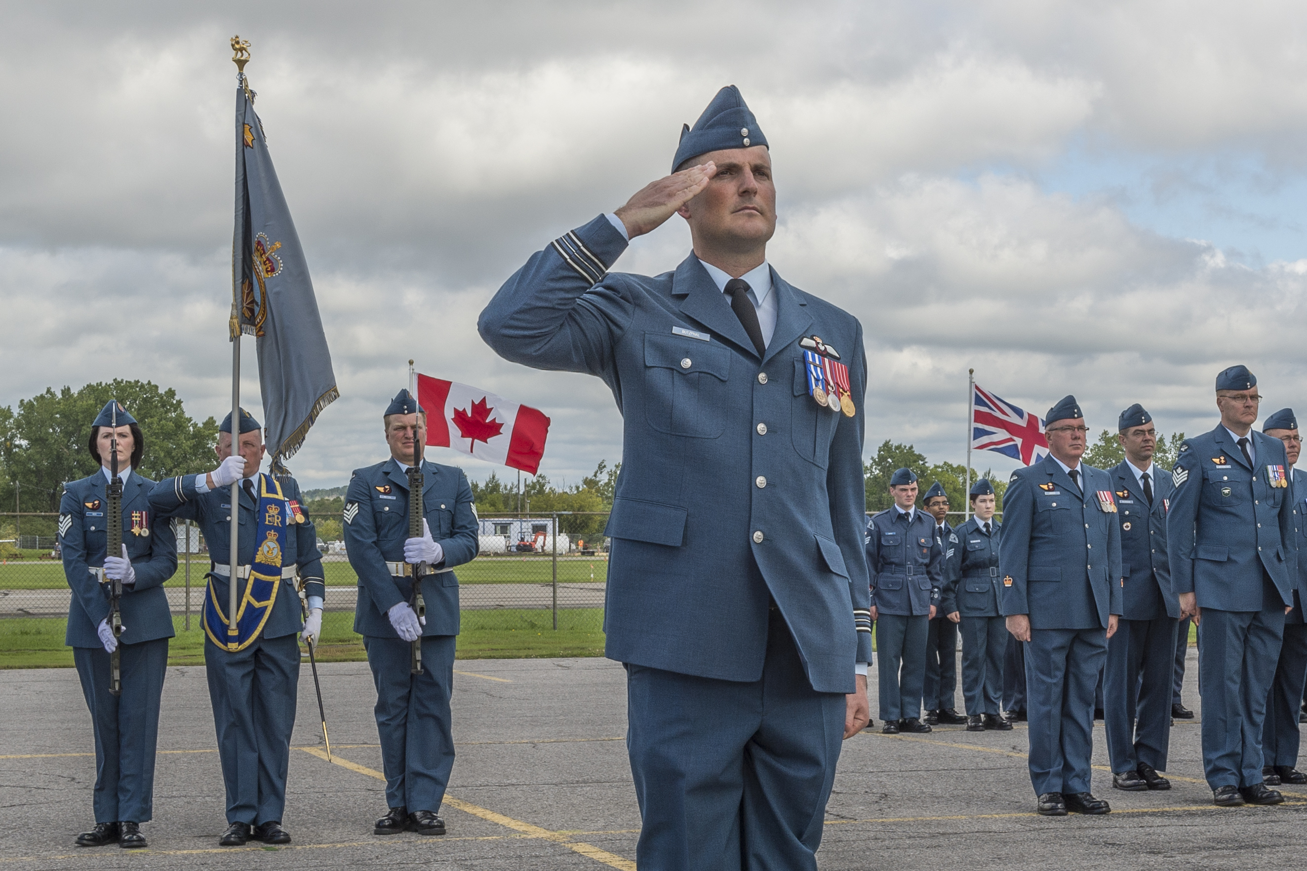 A man wearing an Air Force uniform salutes.