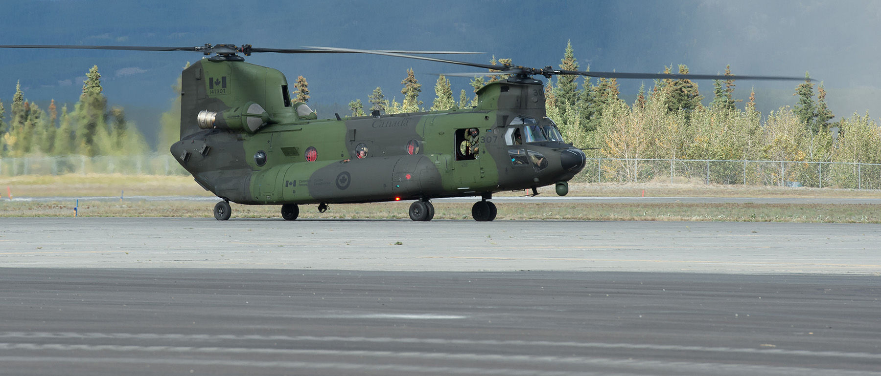A Royal Canadian Air Force CH-147 Chinook helicopter from 450 Tactical Helicopter Squadron taxis on the runway at Erik Nielson Airport in Whitehorse, Yukon, on August 24, during Operation Nanook 2016. PHOTO: Corporal Chase Miller, SU11-2016-1061-051