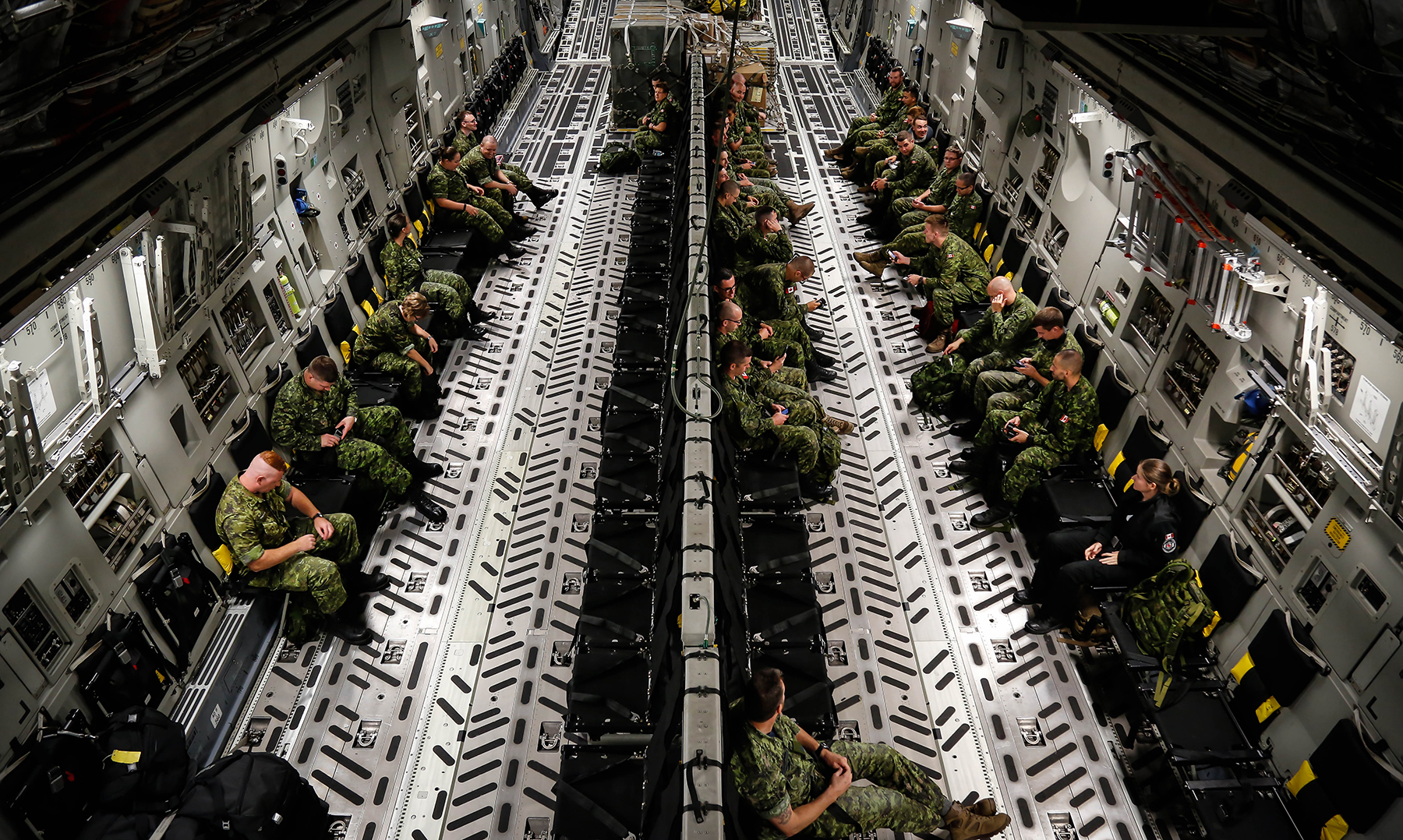 Members of the Canadian Armed Forces deployed on Nanook 2016 settle into a Royal Canadian Air Force CC-177 Globemaster III.