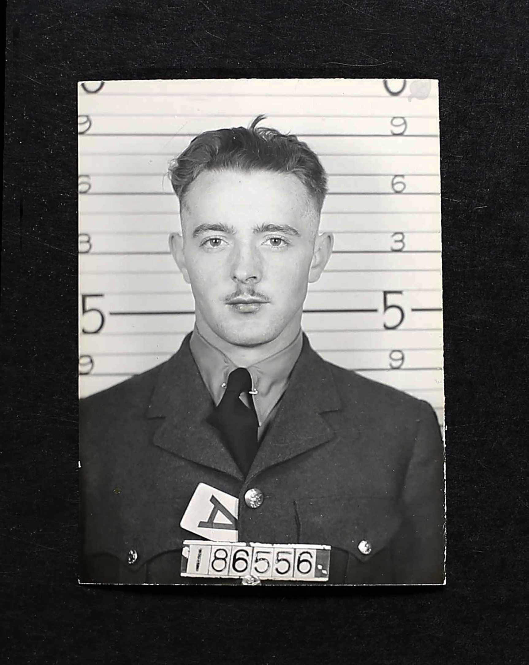 Sergeant Ronald Zimmer's military photograph shows his height, service number, blood type, and cowlick. The youngest of his crew, Sergeant Zimmer had celebrated his 20th birthday just three weeks and two days before he and his crew were killed when their Lancaster bomber was shot down near the Holland-Germany border on January 2, 1944. Today, like many Saskatchewanians who died in the war, Sergeant Zimmer's service to his country is honoured and remembered by way of a Geo Memorial: Geological feature Zimmer Island, located in eastern Lac La Ronge, one of the largest lakes in Saskatchewan, bears his name. PHOTO: Courtesy of Sharon Zimmer