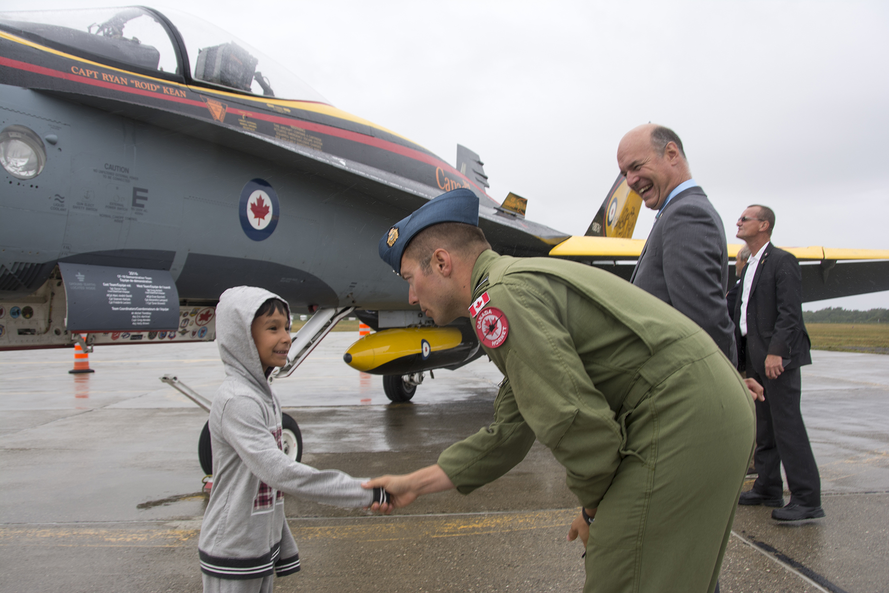 Captain Ryan Kean, pilot of the 2016 Demonstration CF-188 Hornet fighter, meets a seemingly star-struck attendee of the ceremony marking the 75th anniversary of the standing up of No. 9 Bombing and Gunnery School in Mont Joli, Québec. PHOTO: Jean-Pierre Bonin