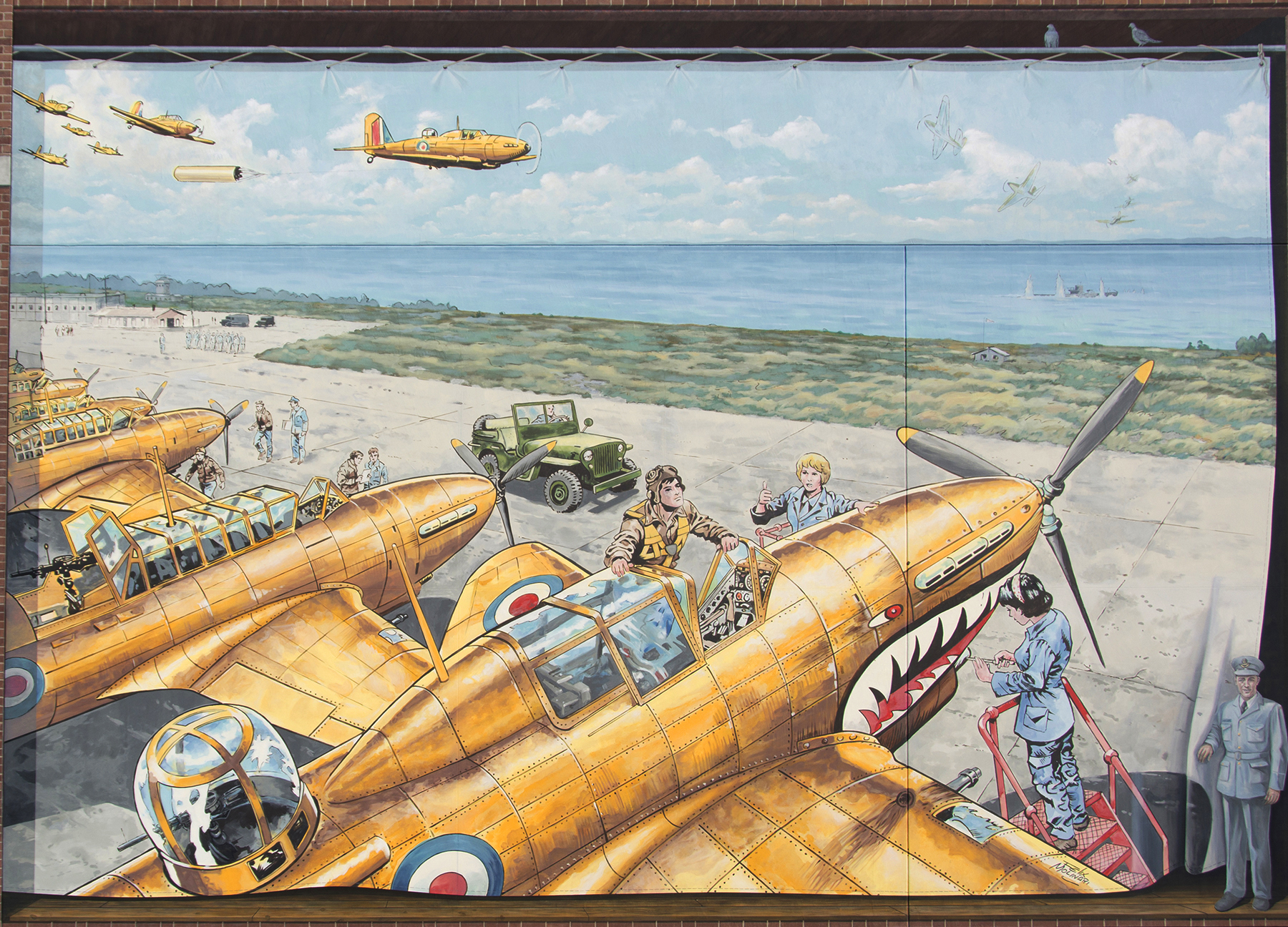 In a painting, fighter aircraft, led by one towing a target drogue, head over a river, while others are serviced on an airfield.
