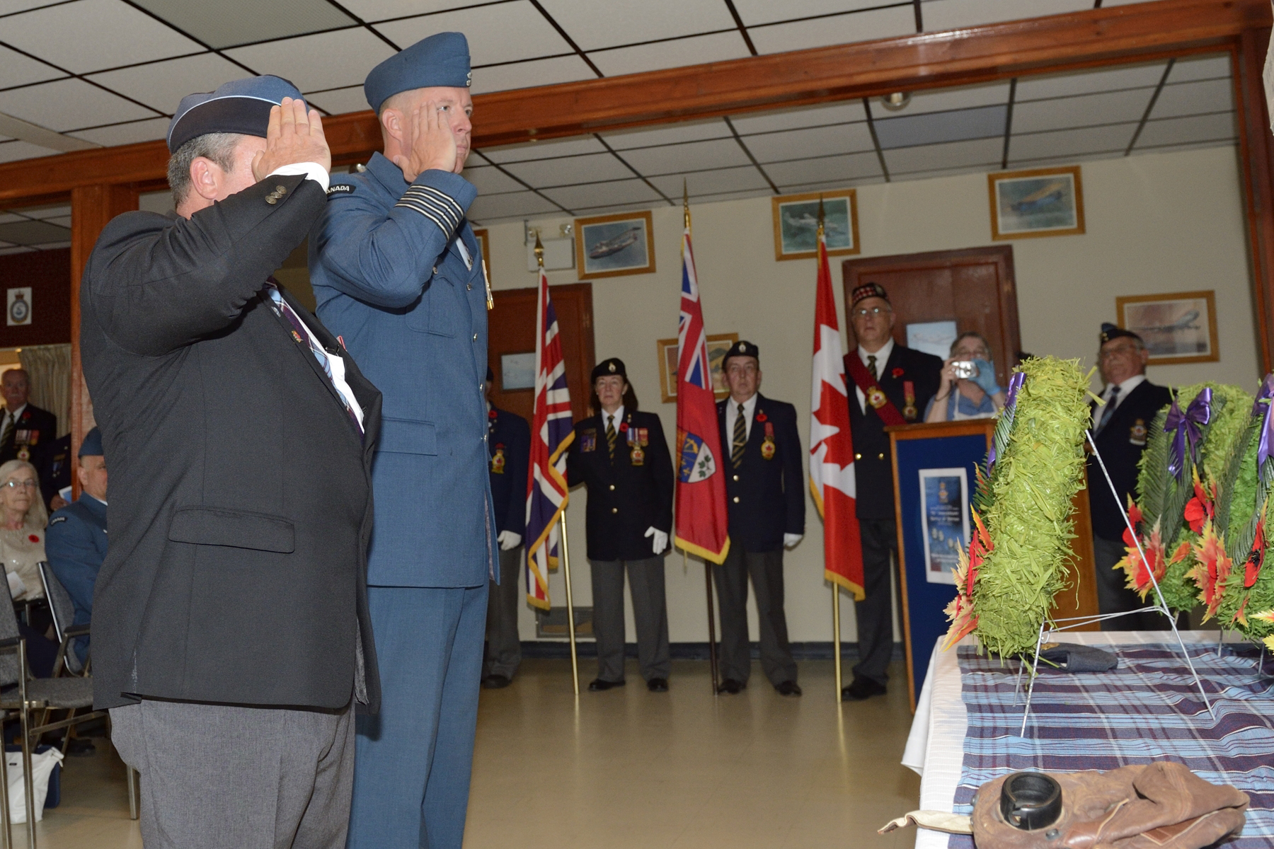 Royal Canadian Air Force Association 107 chapter president Alex Madaire (left) and 14 Wing Greenwood, Nova Scotia, wing commander Colonel Patrick Thauberger salute after laying a wreath at the monument during the 2016 Battle of Britain parade held in the 107 RCAF Association building in Greenwood on September 18, 2016. PHOTO: Corporal Daniel Salisbury, GD2016-0549-04