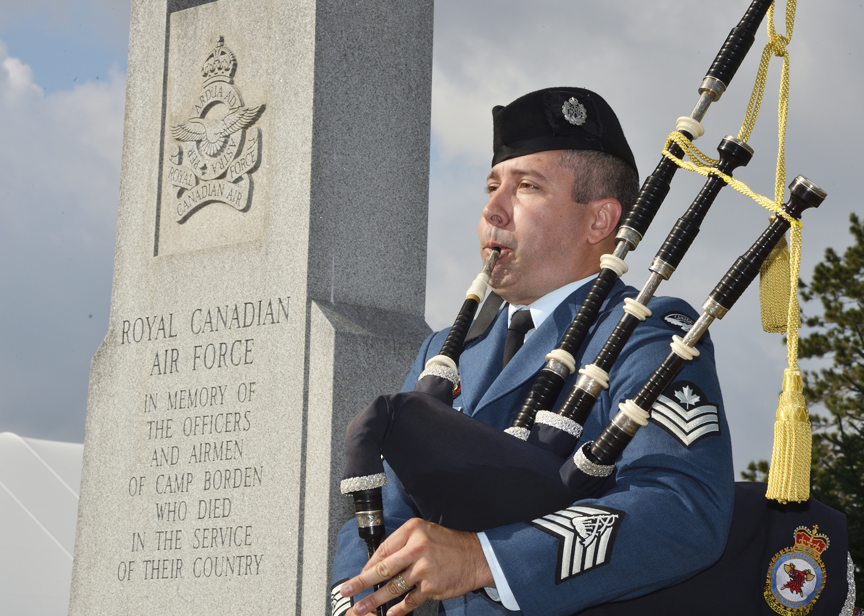 Sergeant Matthew MacIsaac pipes the Lament during the Battle of Britain parade held at the Royal Canadian Air Force cenotaph at Canadian Forces Base Borden, Ontario, on September 18, 2016. PHOTO: Master Corporal Miranda Langguth, BM02-2016-0271-17