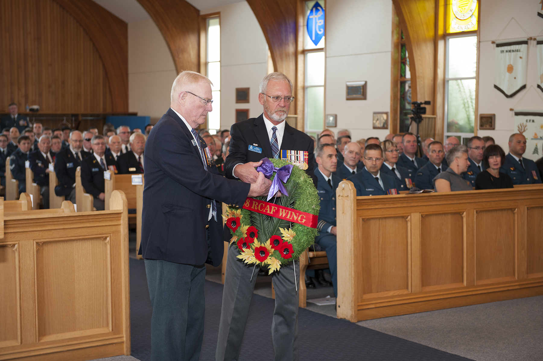 Colonel (retired) Ted Gibbons (left), vice-president of 888 Wing Royal Canadian Air Force Association, and Chief Warrant officer (retired) Ron Western, 888 president, lay a wreath during the 19 Wing Comox, British Columbia, Battle of Britain Commemorative Service held on September 18, 2016, in St. Michael and all Angels Chapel. PHOTO: Sergeant Halina Folfas, CX03-2016-0374-11
