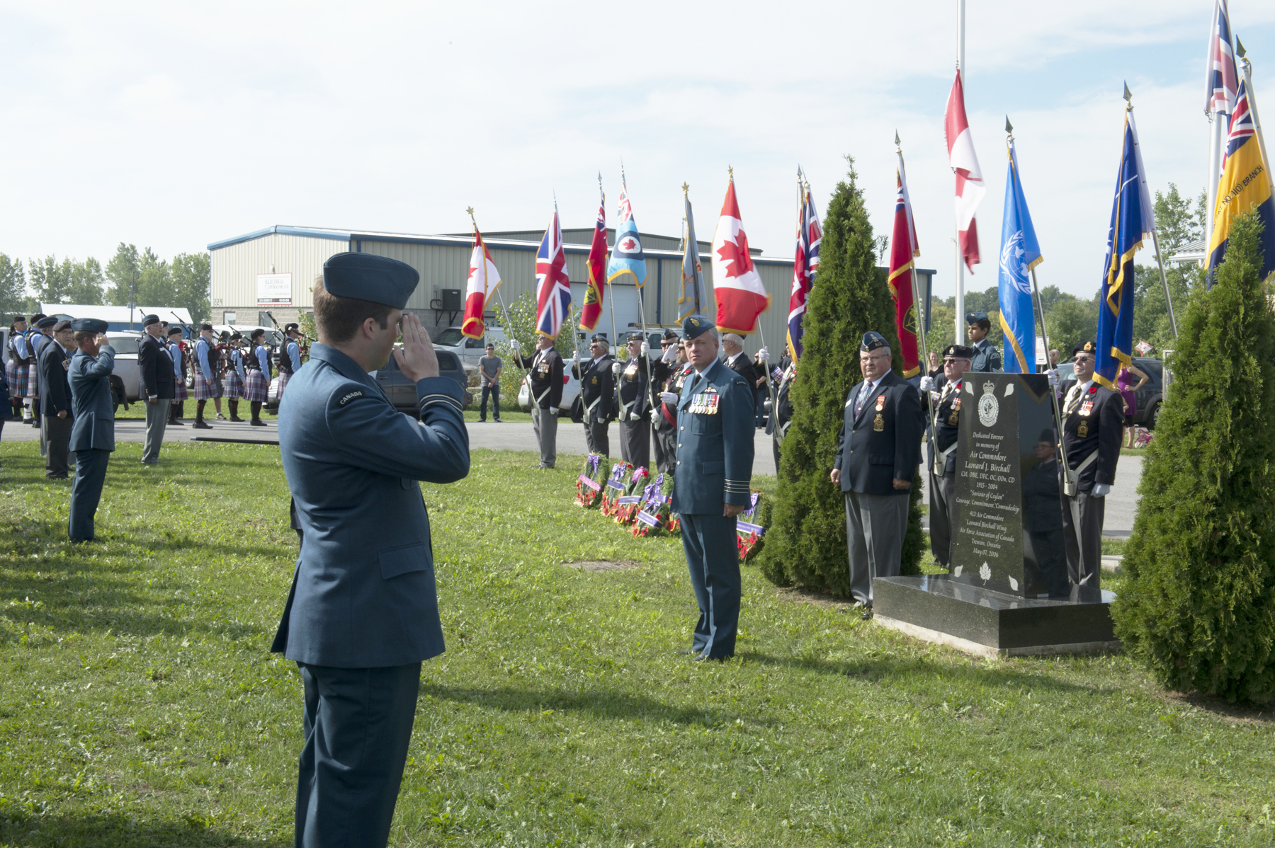 Battle of Britain parade members salute 8 Wing commander and reviewing officer Colonel Colin Keiver during the Battle of Britain parade held at the 413 (Air Commodore Leonard Birchall) Wing Air Force Association of Canada in Trenton, Ontario, on September 18, 2016. PHOTO: Corporal Owen W. Budge, TN10-2016-0688-007