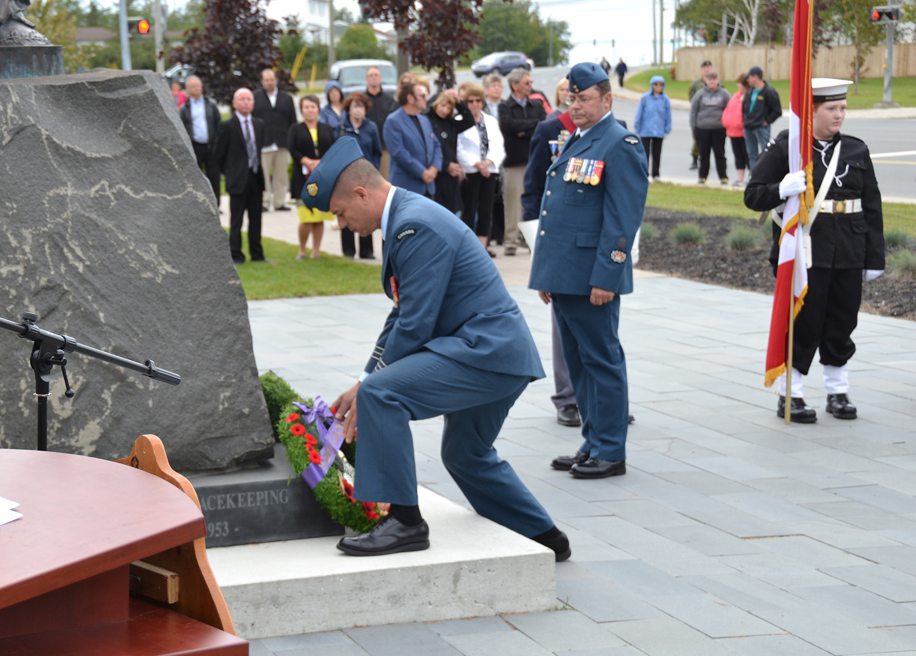 9 Wing commander Lieutenant-Colonel Pierre Haché lays a wreath at the Town of Gander Heritage Memorial Park on Sunday, 18 September 2016, during the 76th Anniversary of the Battle of Britain Ceremony. PHOTO: Sergeant Carter MacLellon