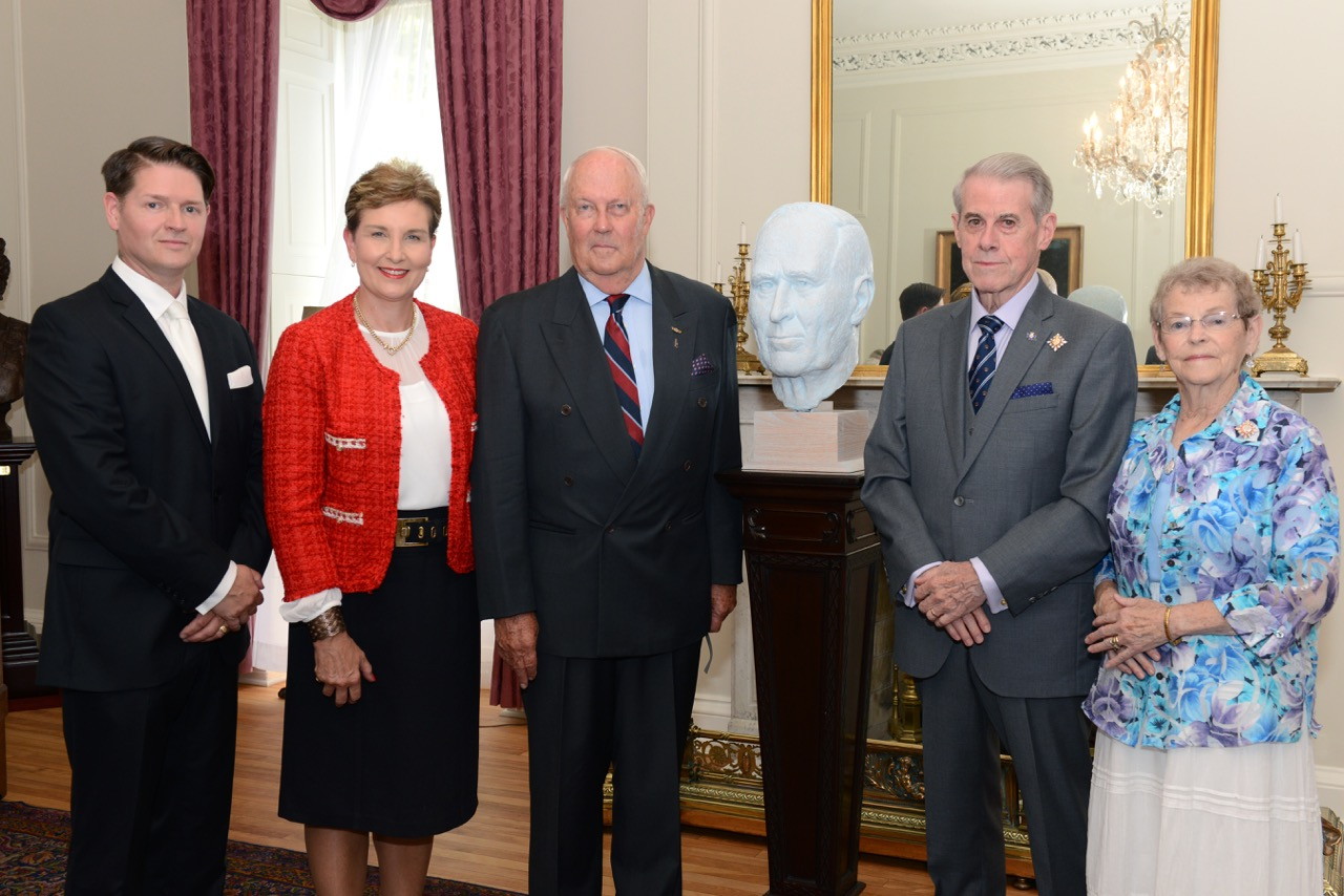 From left to right: Mr. Christian Corbet, artist; Mrs. Amanda Haddon; Honorary Colonel Gerald Haddon; Lieutenant Governor J.J. Grant; and Mrs. Joan Grant with the portrait bust of J.A.D. McCurdy at Government House in Halifax, Nova Scotia. Mr. McCurdy was Canada's first pilot, flying the Silver Dart on February 23, 1909, and also a lieutenant governor of Nova Scotia. Hon-orary Colonel Haddon recalls visiting him at Government House. PHOTO: Michael Creagen