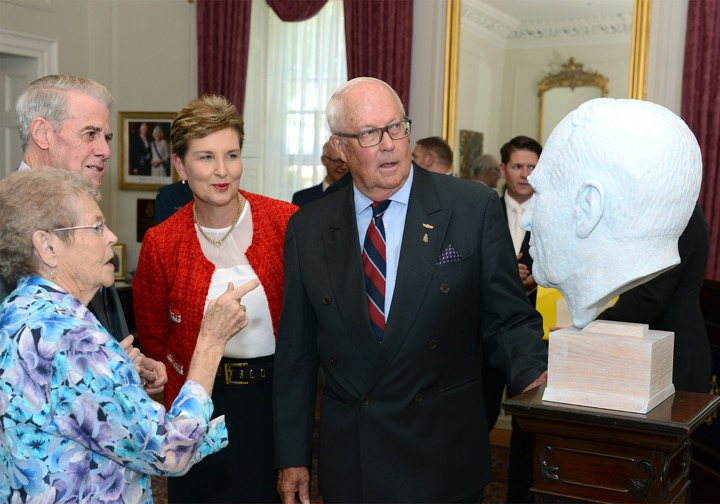 (From left to right) Mrs. Joan Grant, Lieutenant Governor J.J. Grant, Mrs. Amanda Haddon and Honorary Colonel Gerald Haddon examine the portrait bust of J.A.D. McCurdy at Government House in Halifax, Nova Scotia. PHOTO: Michael Creagen