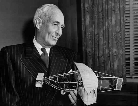 J.A.D. McCurdy holds a model of the Silver Dart on February 23, 1959 – the 50th anniversary of his historic flight in this aircraft in Baddeck, Nova Scotia. PHOTO: Haddon family via innova-tioncanada150.ca