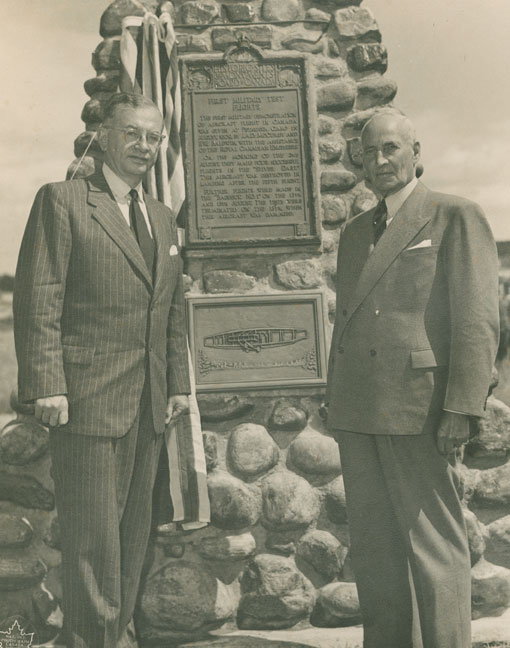 "In August 1952, the Minister of National Defence, Brooke Claxton, and J.A.D. McCurdy partici-pate in the unveiling of a cairn in Petawawa, Ontario. The plaque reads: ""FIRST MILITARY TEST FLIGHTS. The first military demonstration of aircraft flight in Canada was given at Petawawa Camp in August 1909 by J.A.D McCurdy and F.W. Baldwin, with the assistance of the Royal Canadian Engineers. On the morning of the 2nd of August they made four successful flights in the 'Silver Dart.' This aircraft was destroyed in landing after the fifth flight. Further flights were made in the 'Baddeck No. 1' on the 12th and 13th August. The tests were terminated on the 13th when this aircraft was damaged."" PHOTO: Nova Scotia Archives, no. 2007-058/003 no. 258"