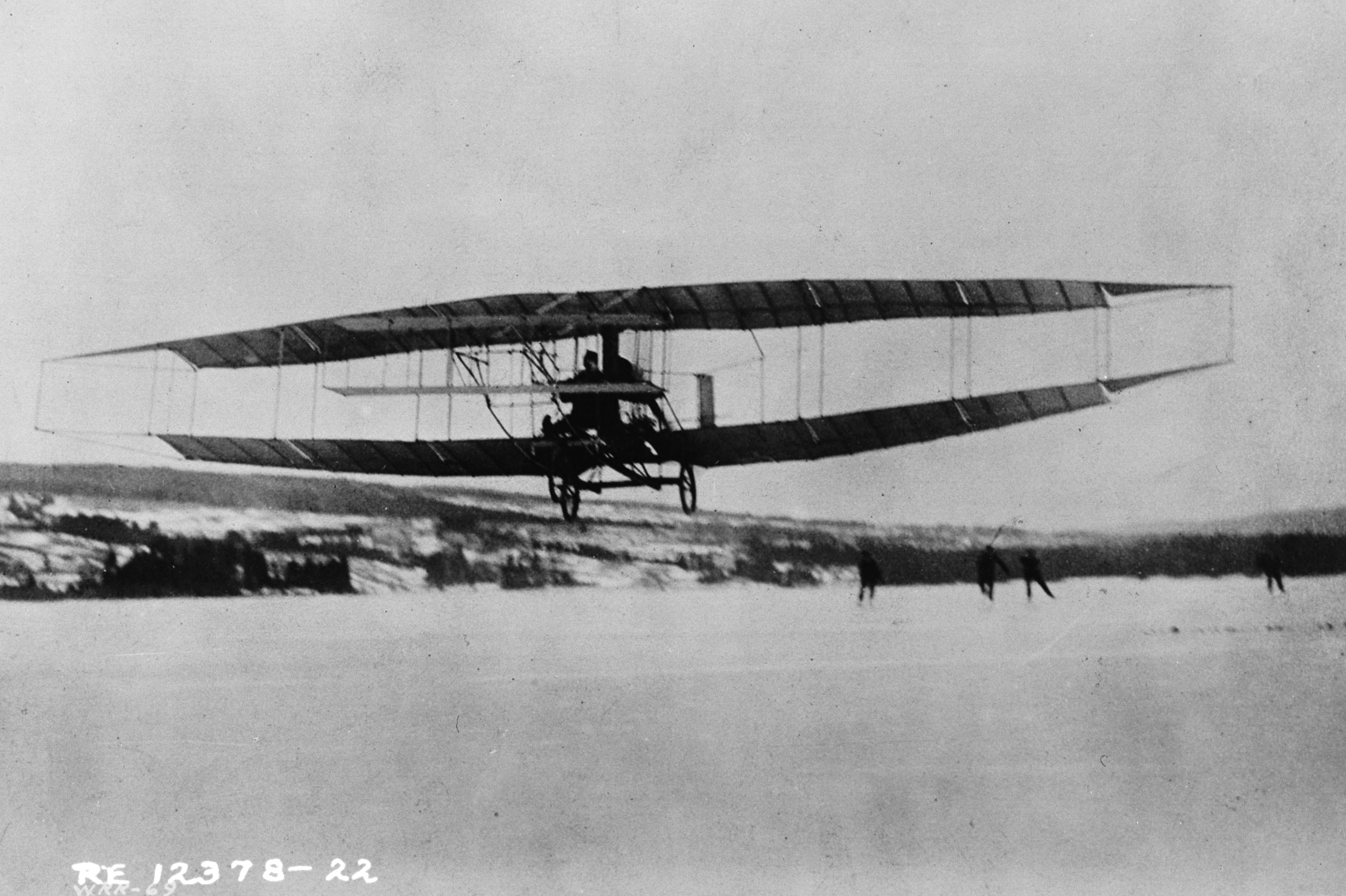 J.A.D. McCurdy takes flight in the Silver Dart – the British Empire's first powered, heavier-than-air flight – on February 23, 1909, in Baddeck, Nova Scotia. PHOTO: DND Archives, RE-12378-22