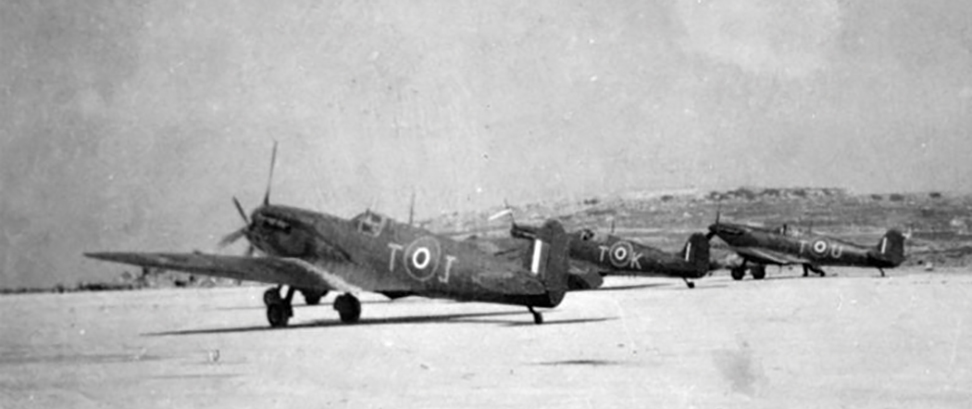 Supermarine Spitfire Vbs of the RAF's 242 Squadron stand at the ready in the blinding sun at Ta' Qali airfield in Malta. PHOTO: Imperial War Museum